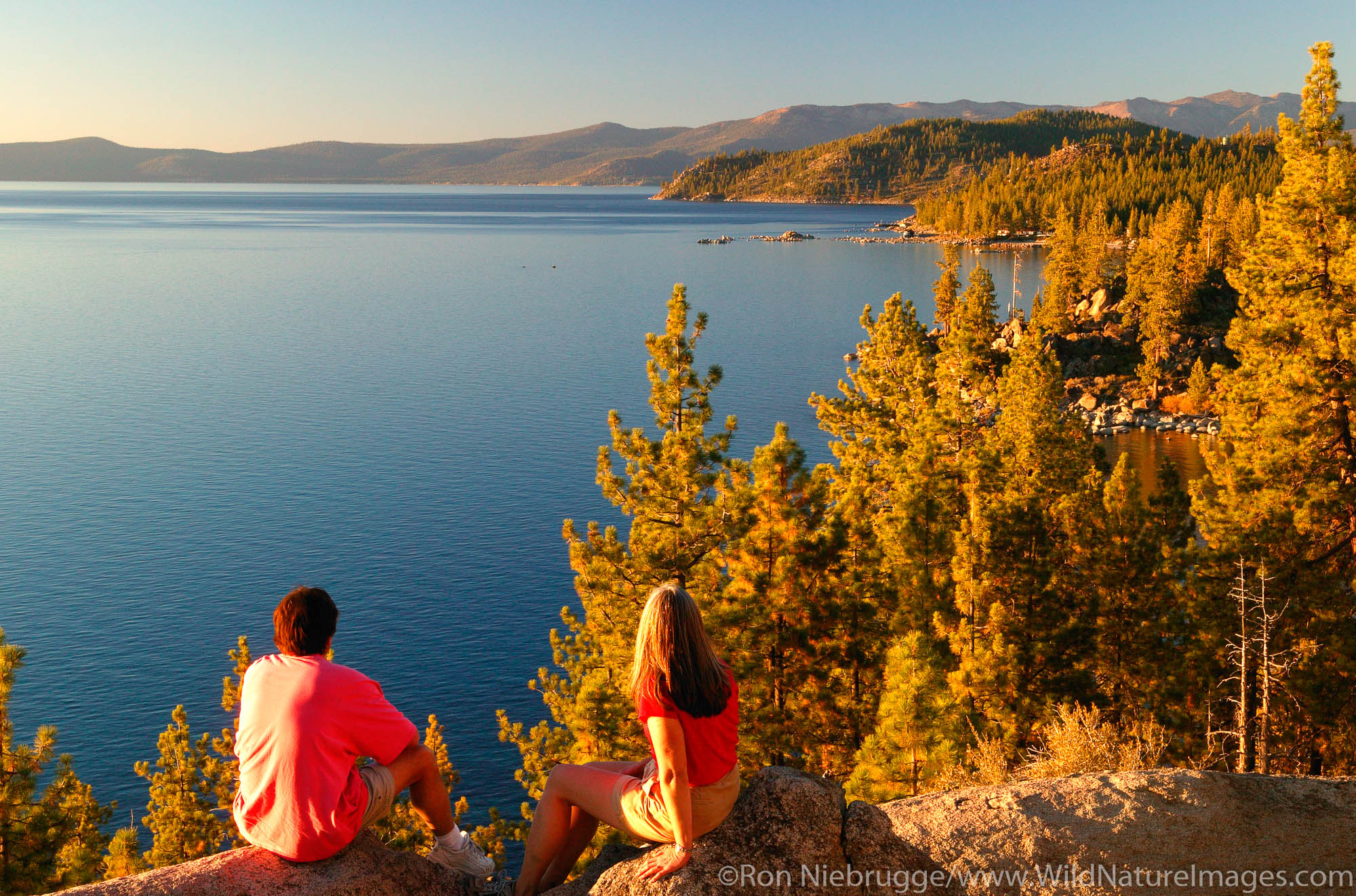 A couple (MR) enjoys the view of Lake Tahoe  from  the Nevada side looking towards California, Lake Tahoe.
