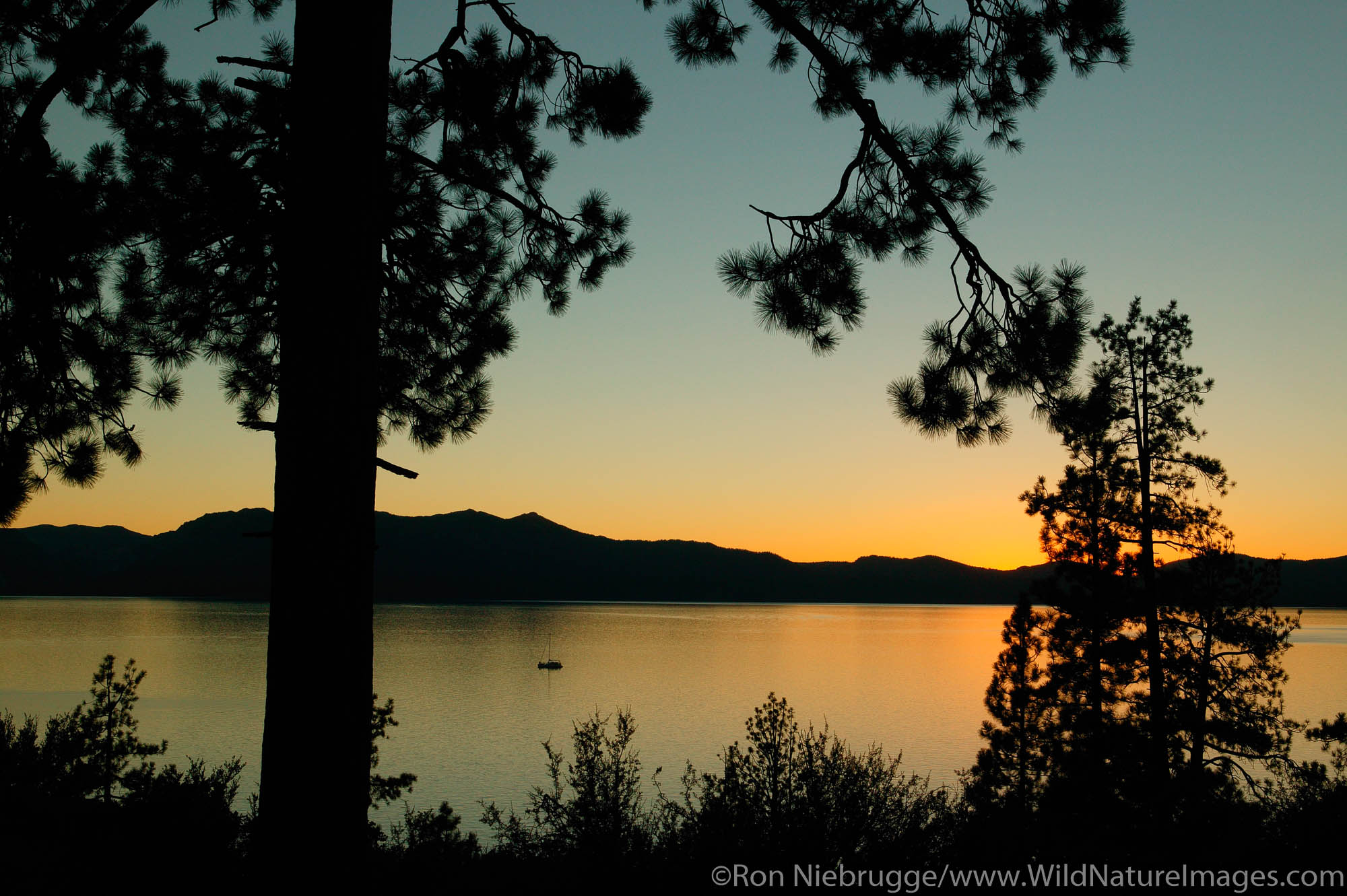 Sailboat on Lake Tahoe at sunset, from Nevada looking towards California.