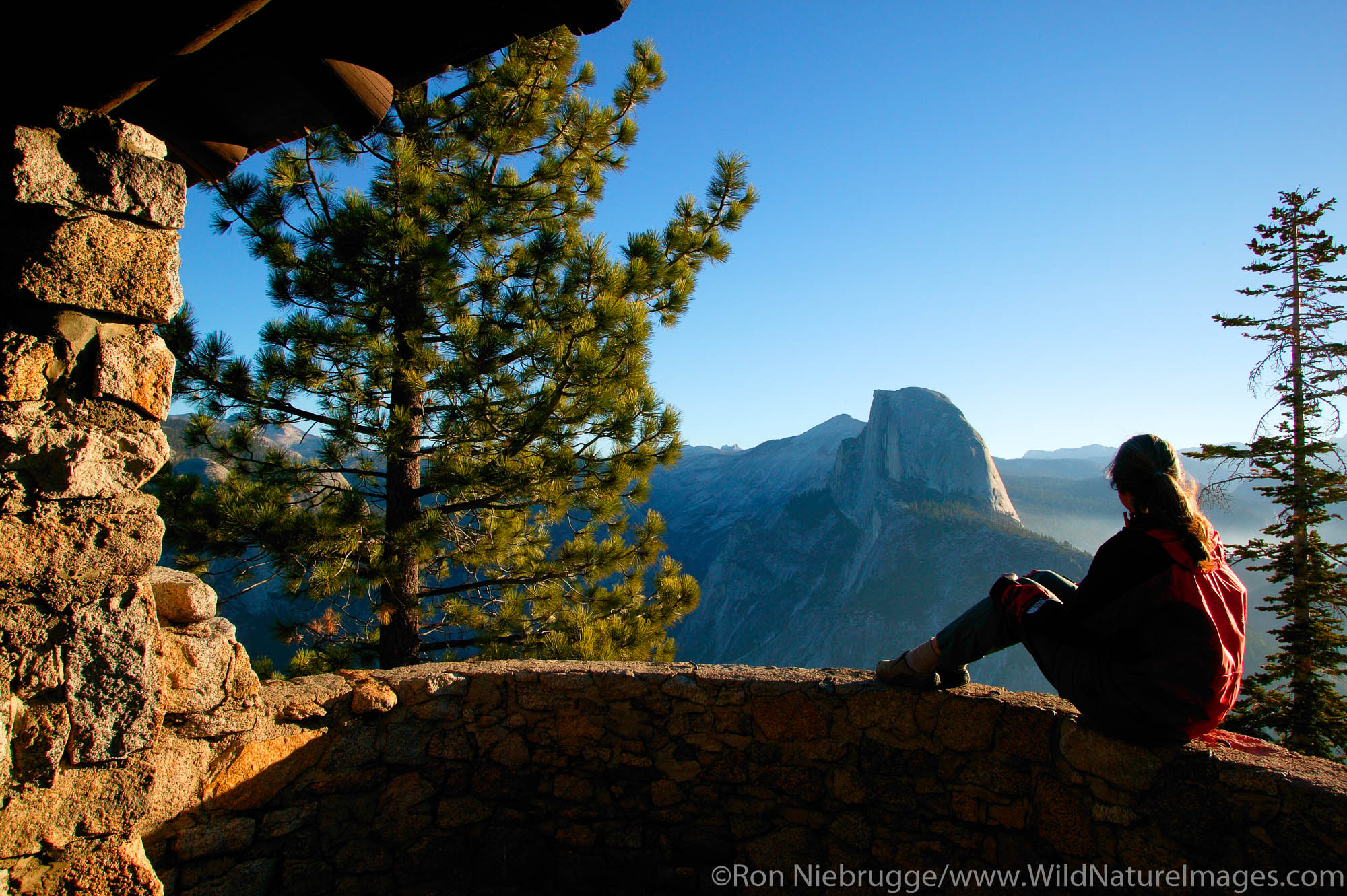 A visitor (MR) views Half Dome from Glacier Point, Yosemite National Park, California.  Model Released.