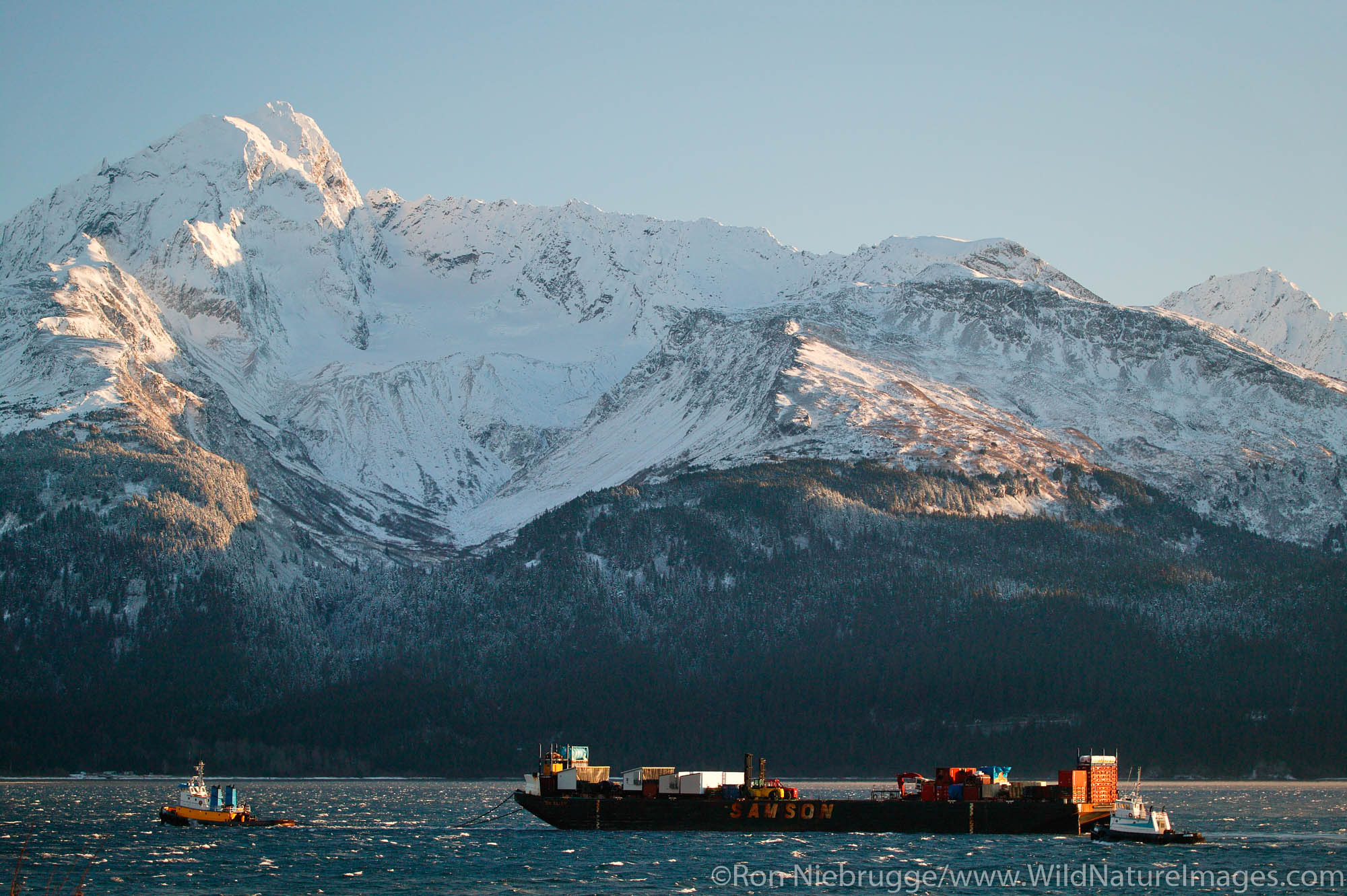 The Samson Barge St Elias is being towed by the tug Ocean Navigator in Resurrection Bay during the winter, Seward, Alaska.