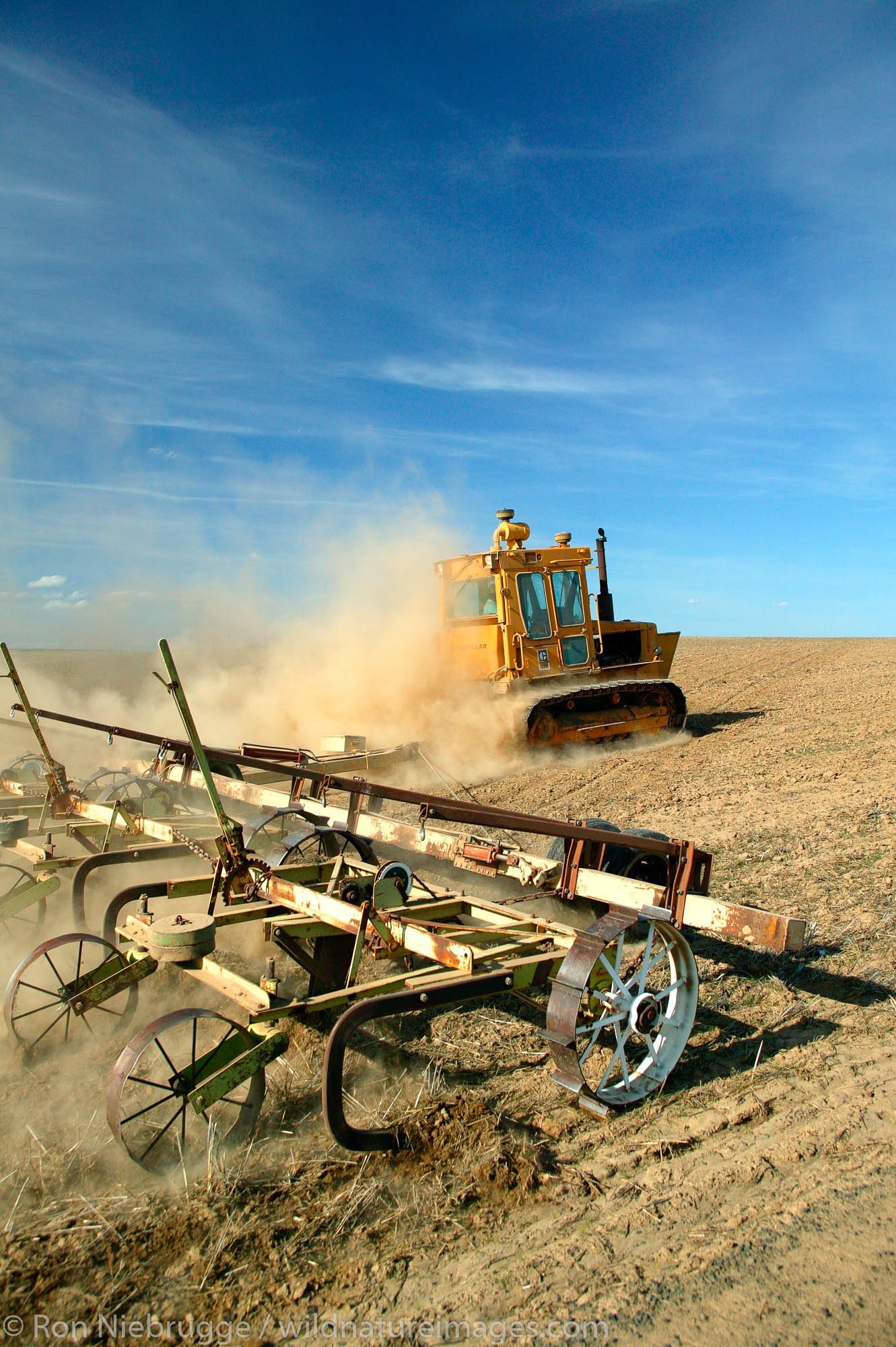 A farmer tills his wheat fields on farmland near Ritzville, Eastern Washington.