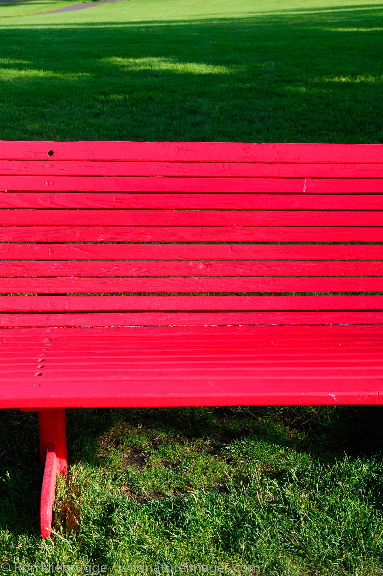 A red bench in Riverfront Park, Spokane, Washington.