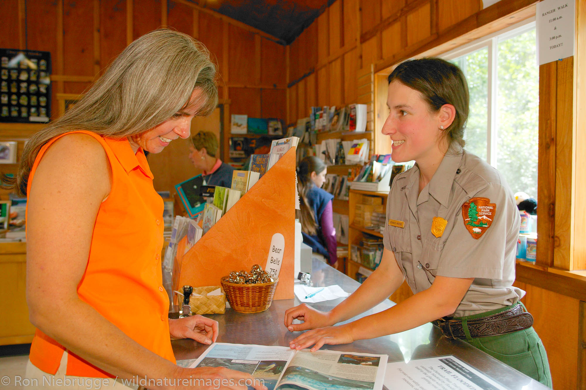 Janine Niebrugge being helped Park employee Bonnie Moore at the Exit Glacier Nature Center, Kenai Fjords National Park, Seward...