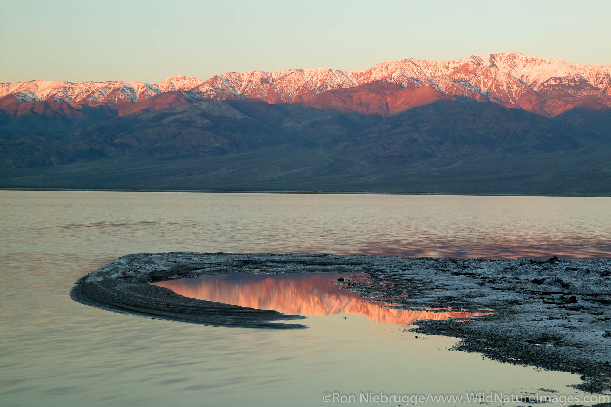 Water from heavy rains fill the Badwater Basin into a lake in 2005.  Death Valley National Park, California.