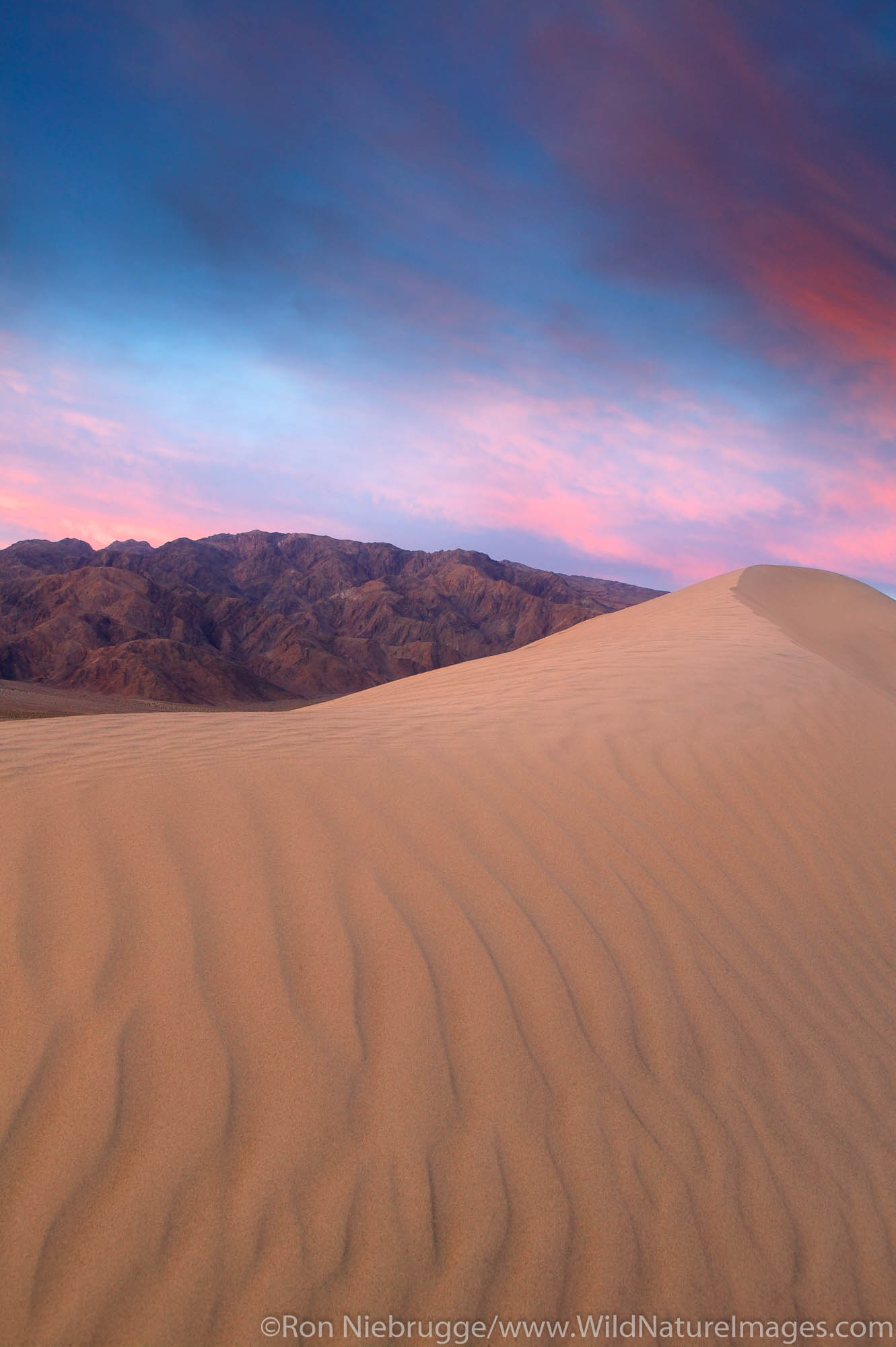 Sand dunes near Stovepipe Wells and Tucki Mountain of the Panamint Range, Death Valley National Park, California.