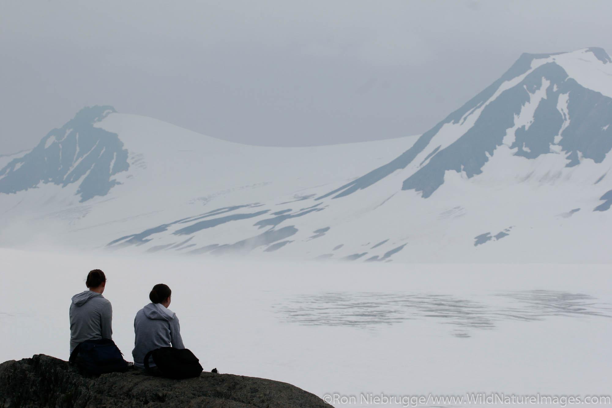 Hikers enjoying the view of the Harding Icefield, Kenai Fjords National Park, Alaska.