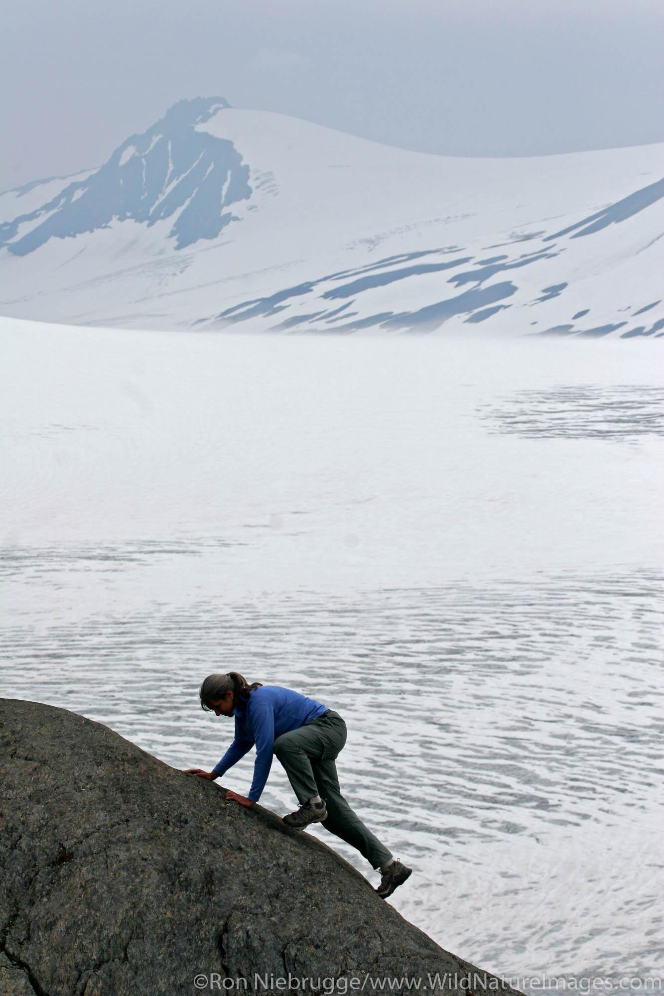 A hiker views Exit Glacier and the Harding Icefield from the Harding Icefield trail, Kenai Fjords National Park, Alaska.  (MR...