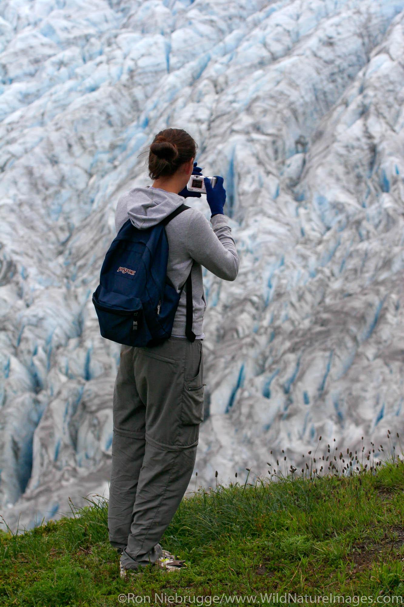 A hiker views Exit Glacier and the Harding Icefield from the Harding Icefield trail, Kenai Fjords National Park, Alaska.