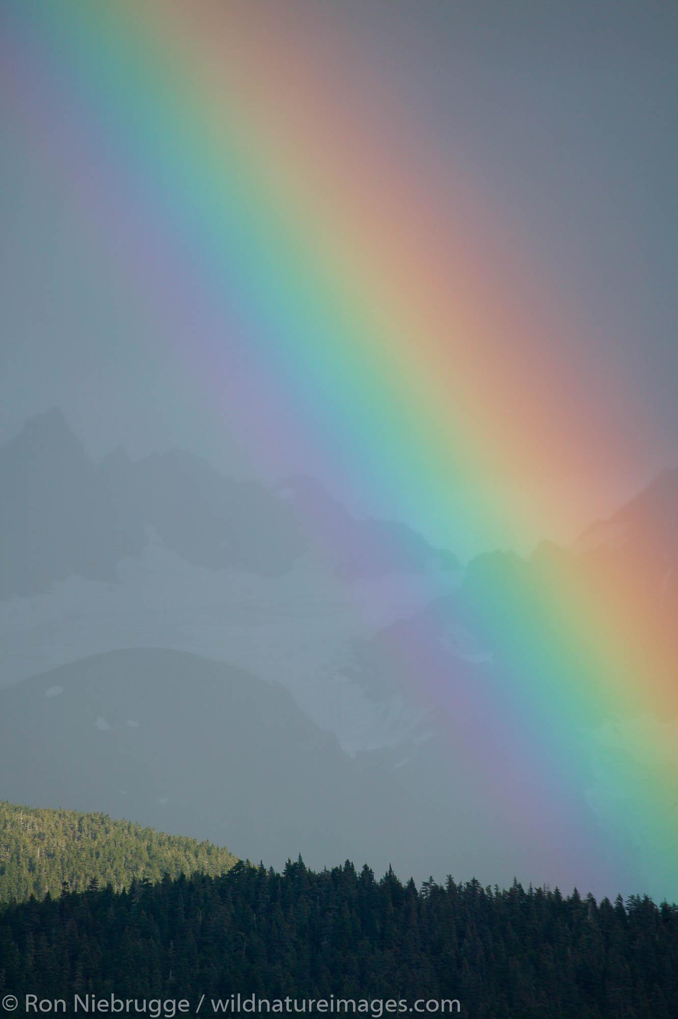 A Rainbow over the mountains of Chugach Natoinal Forest as seen from Seward, Alaska.