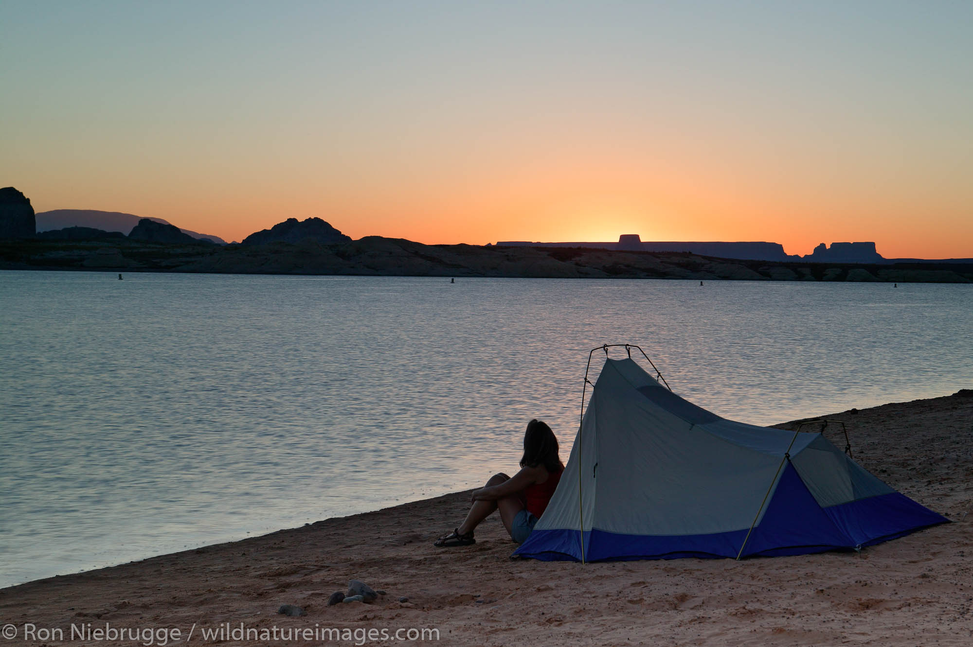 Visitors tent camping at the Lone Rock Primitive Campground, Lake Powell and the Glenn Canyon Recreation Area, Utah.  This is...