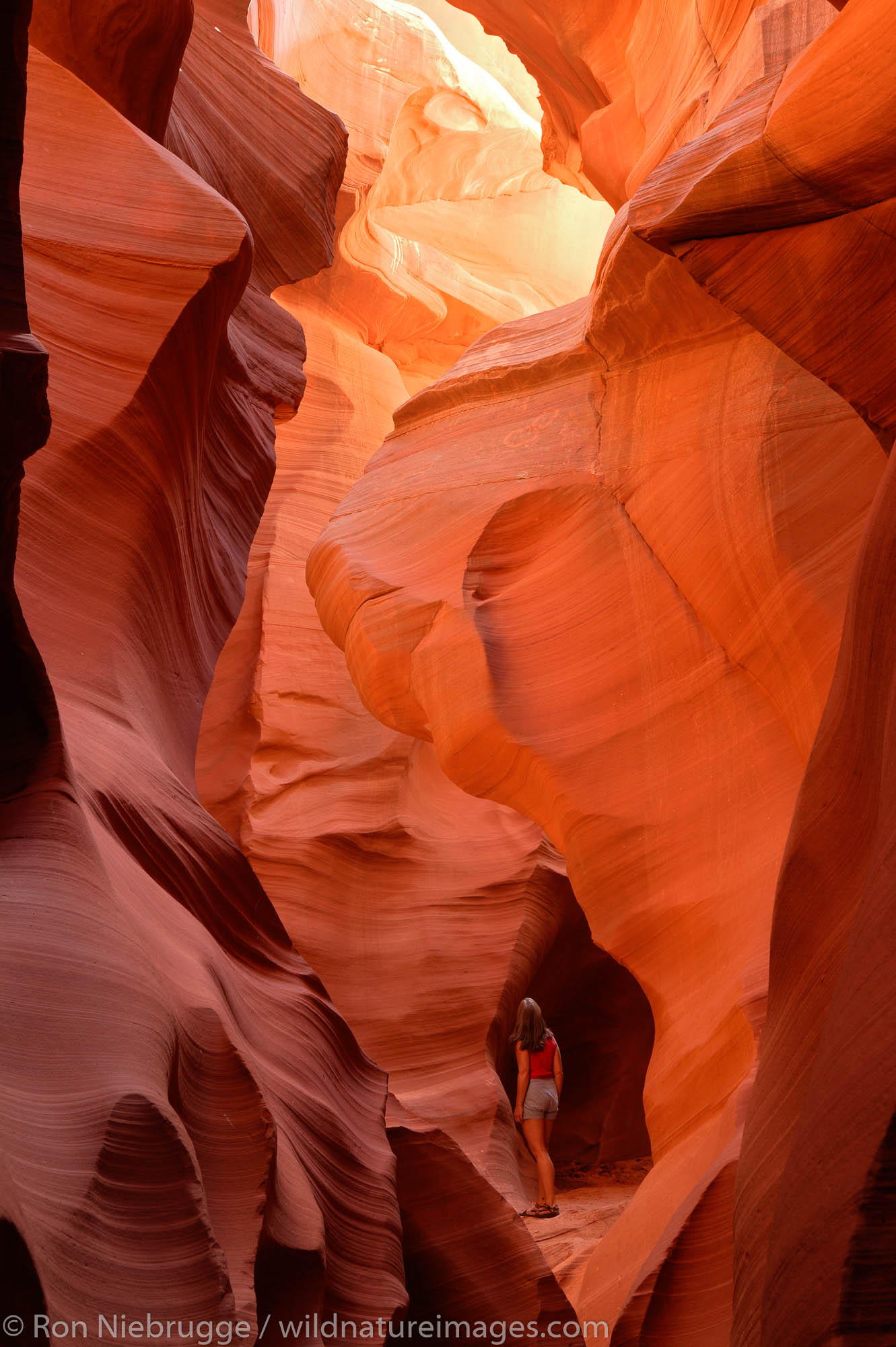 A visitor to the Lower Antelope Canyon, near Page, Arizona. (model released)