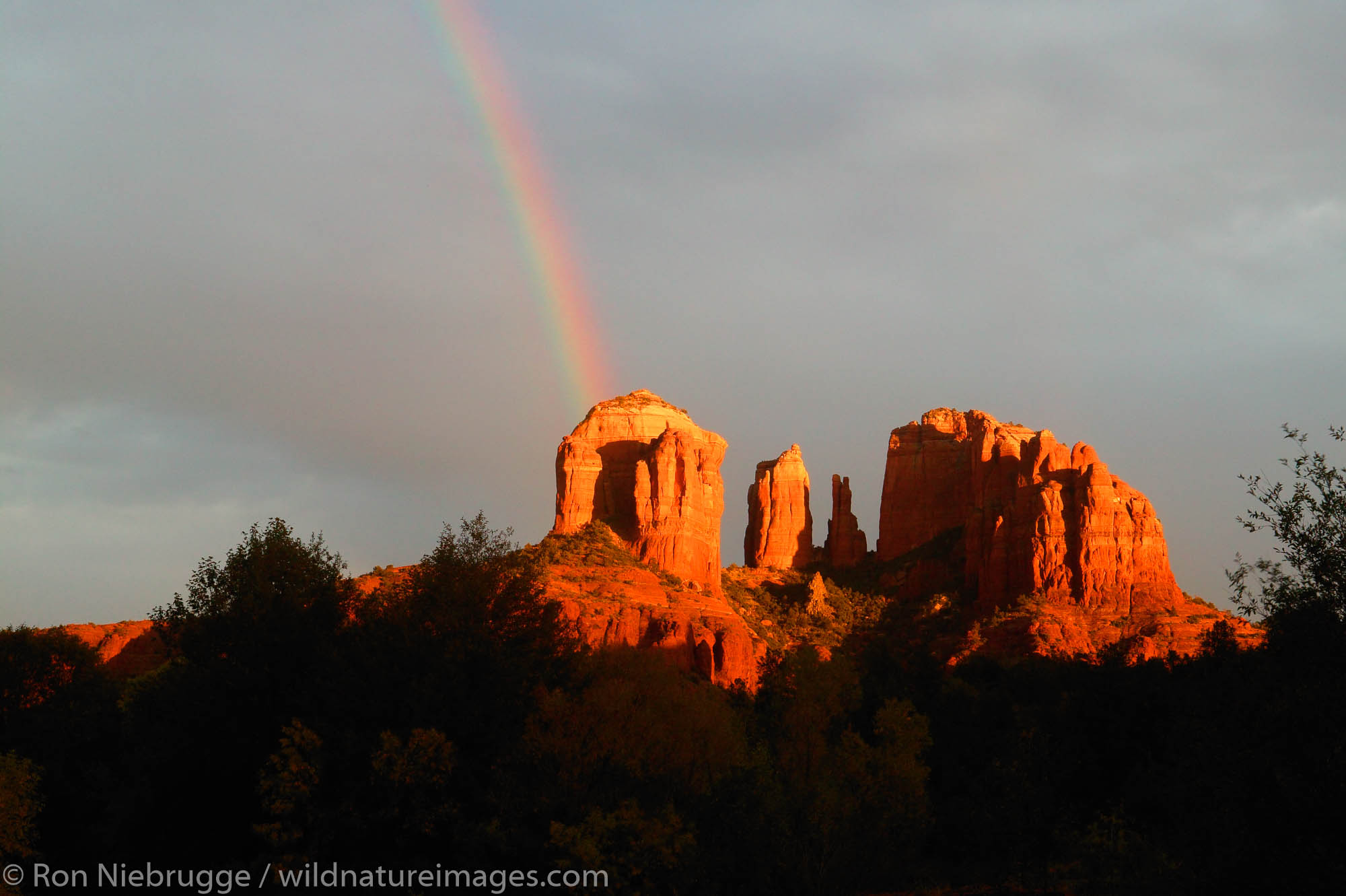 A rainbow over Cathedral Rock and Oak Creek, Sedona, Arizona.