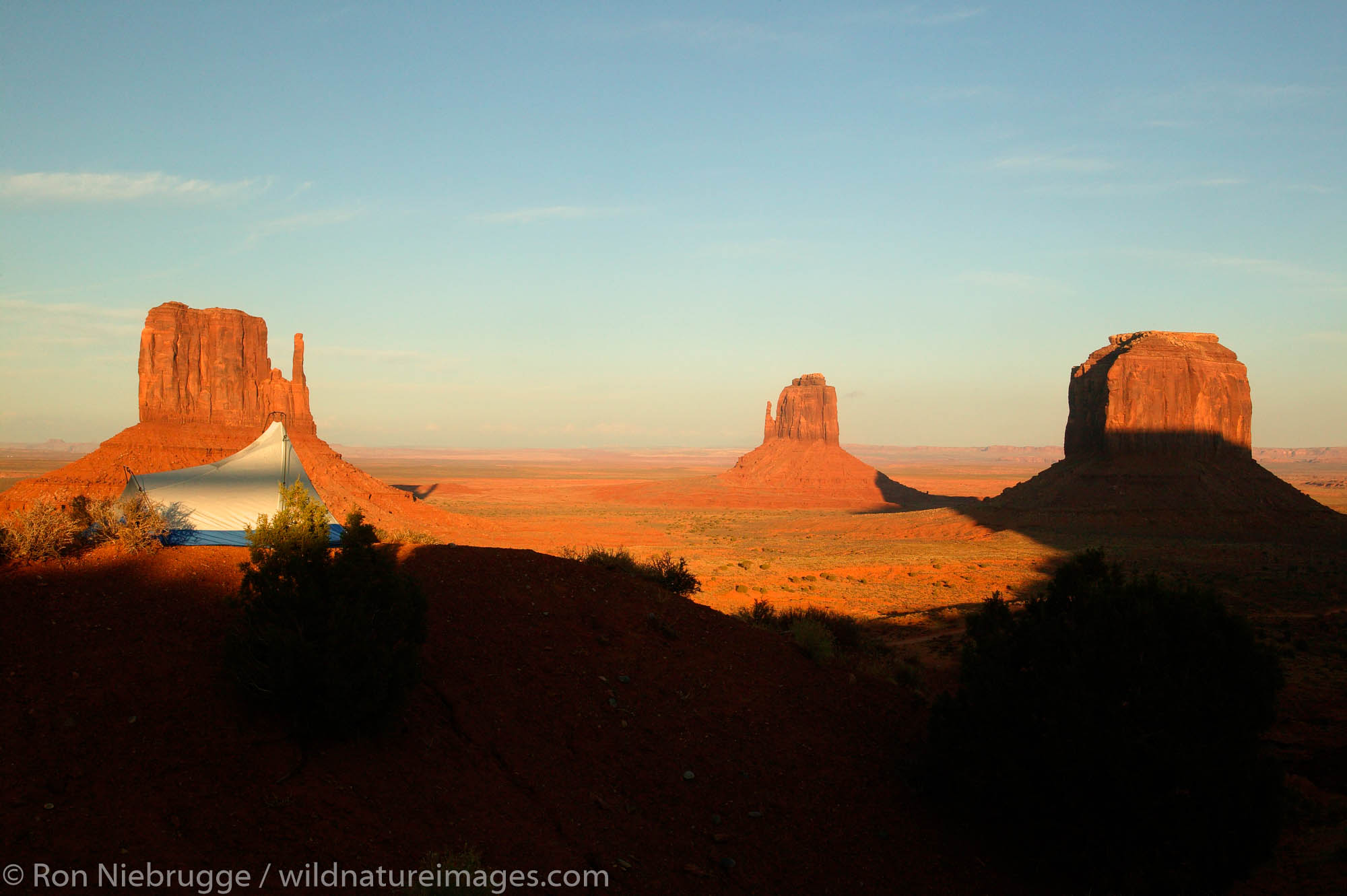 A visitor enjoys the view from camp of Monument Valley Navajo Tribal Park, Utah.  (model released)