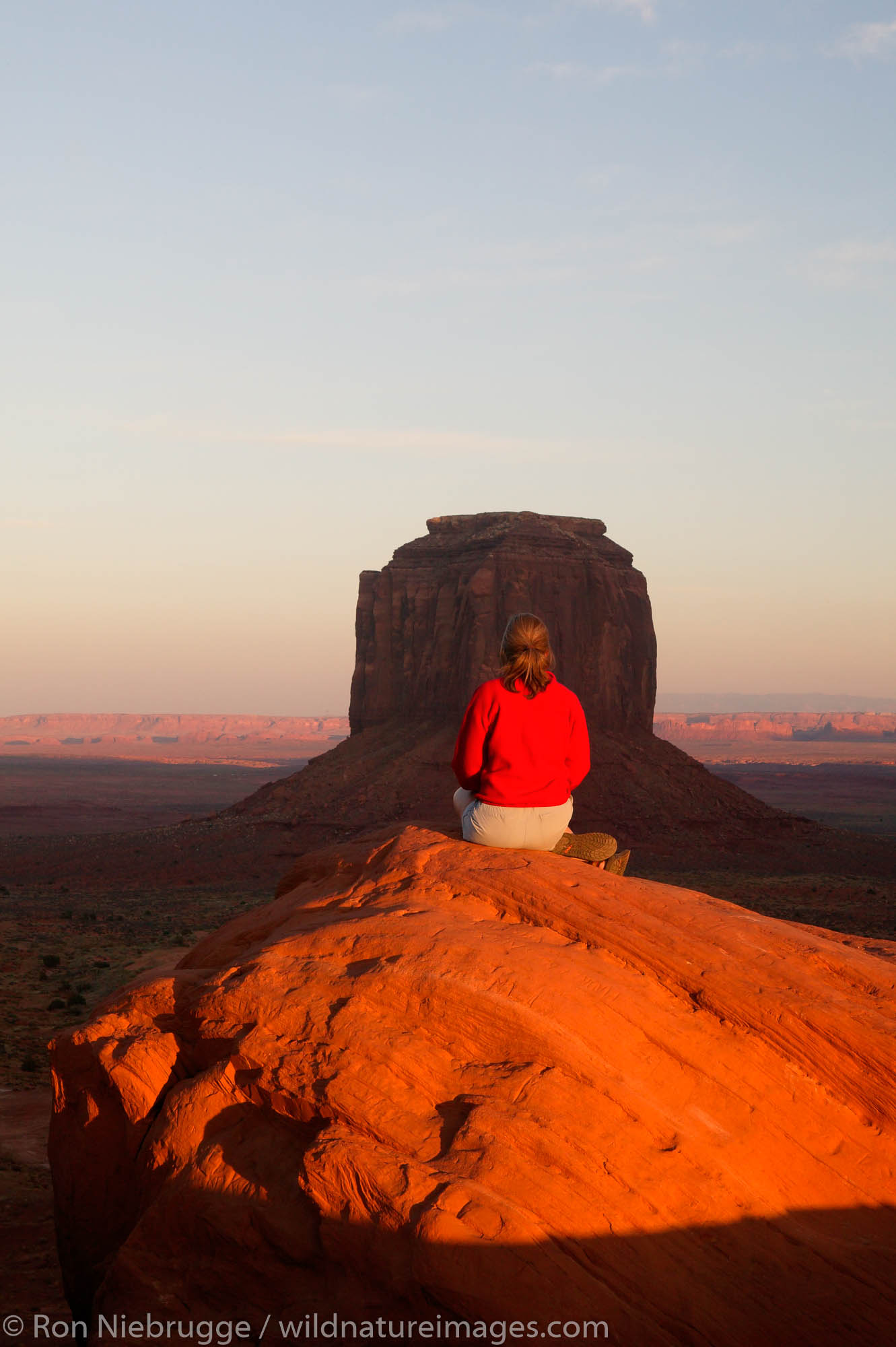 A visitor enjoys the view of Monument Valley Navajo Tribal Park, Utah.  (Model released)