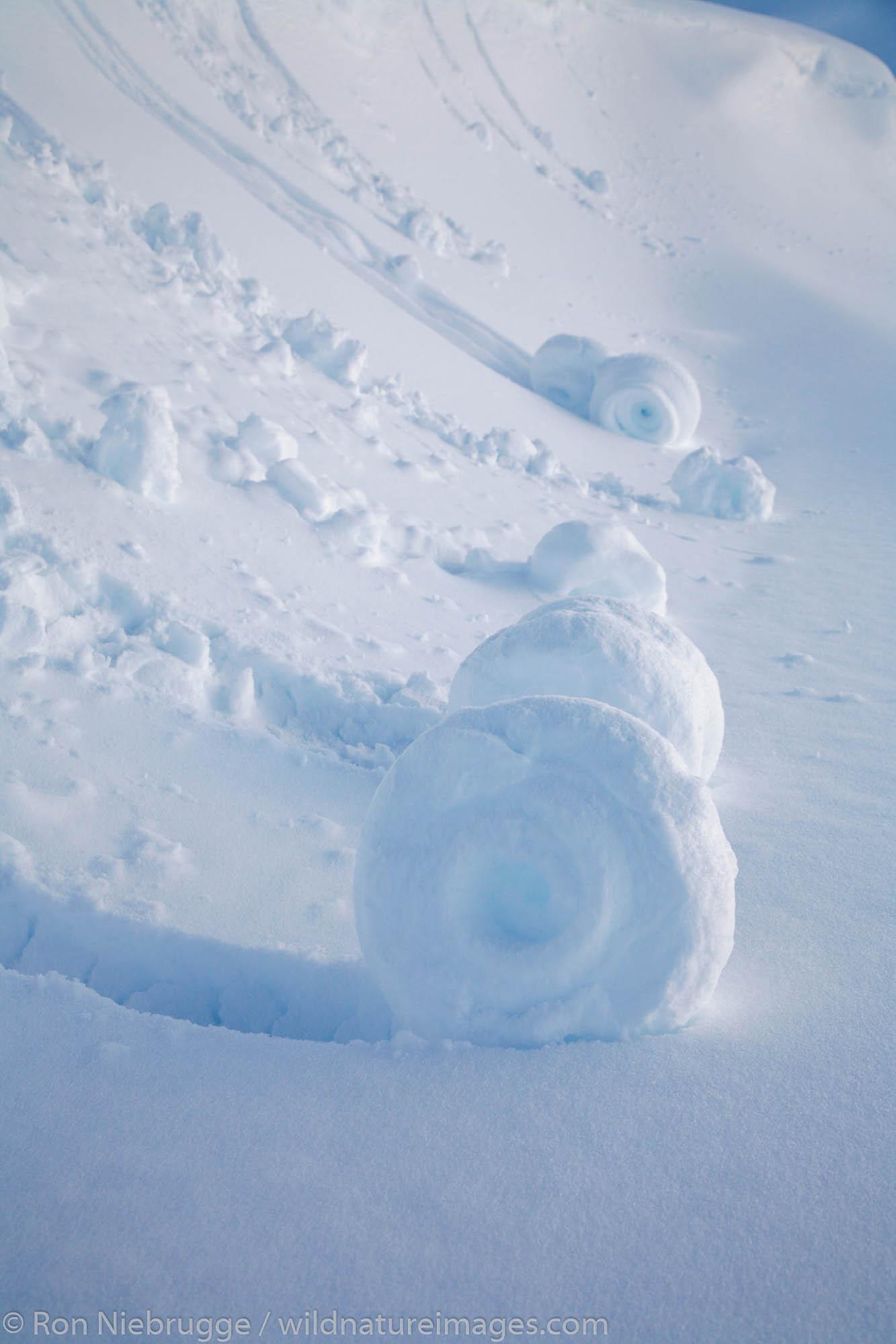 "Snow ""rolls"" created when wet snow broke off a small cornice, Lost Lake region, Chugach National Forest, near Seward, Alaska."