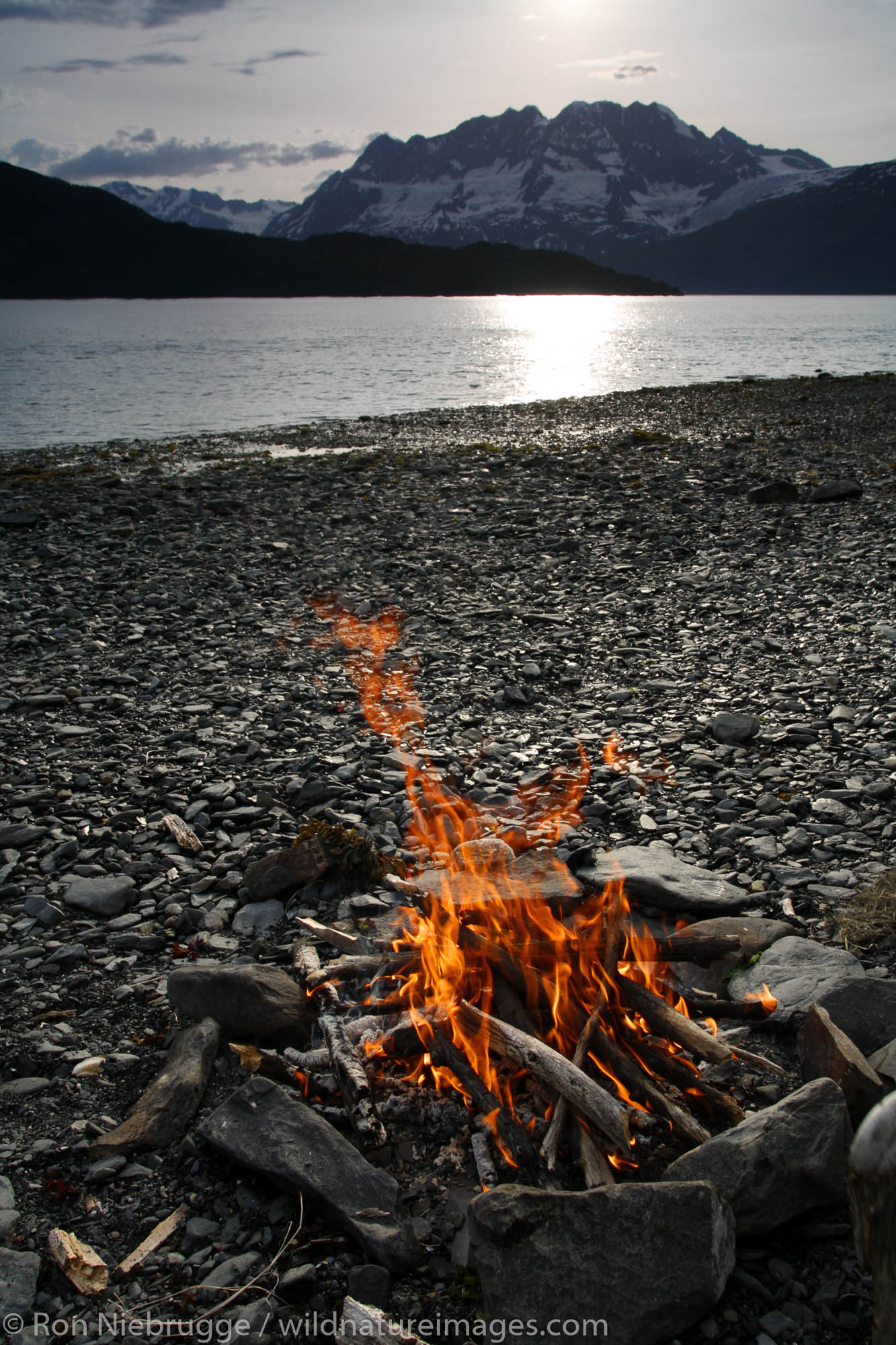 A campfire on the beach, Barry Arm, Prince William Sound, Chugach National Forest, Alaska.