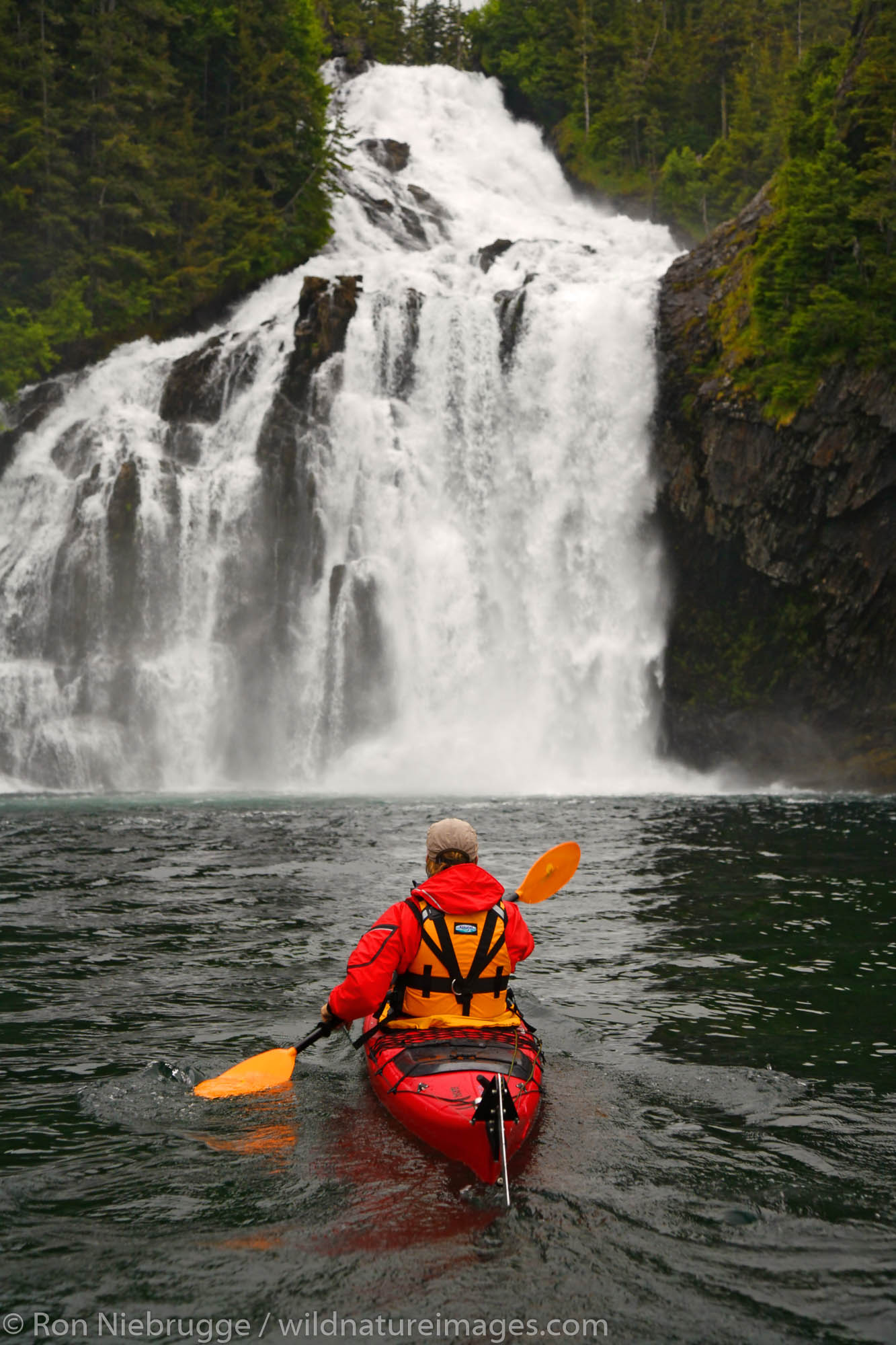 Kayaking near Cascade Falls in Cascade Bay Prince William Sound Chugach National Forest Alaska. (MR)
