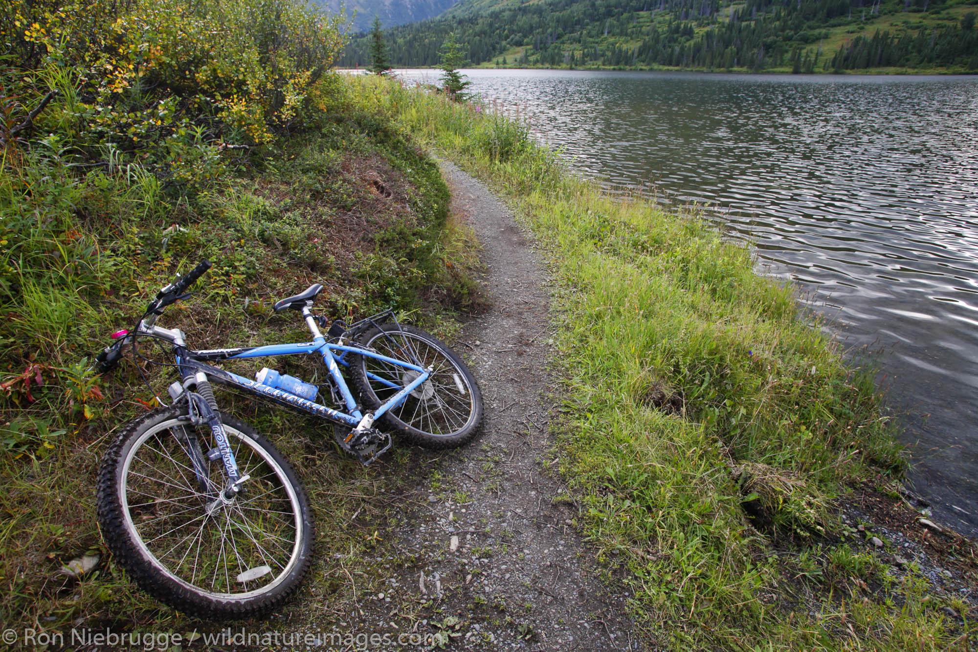 Mountain Bikers stop at Juneau Lake, Resurrection Pass Trail, Kenai Peninsula, Chugach National Forest, Alaska.