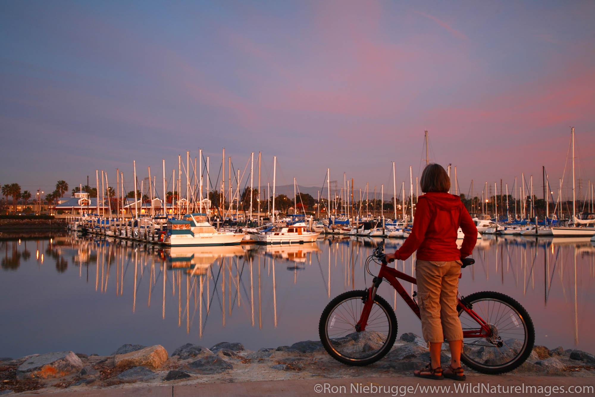A visitor with a bike enjoys the Chula Vista Marina, Chula Vista, California.  (Model released)