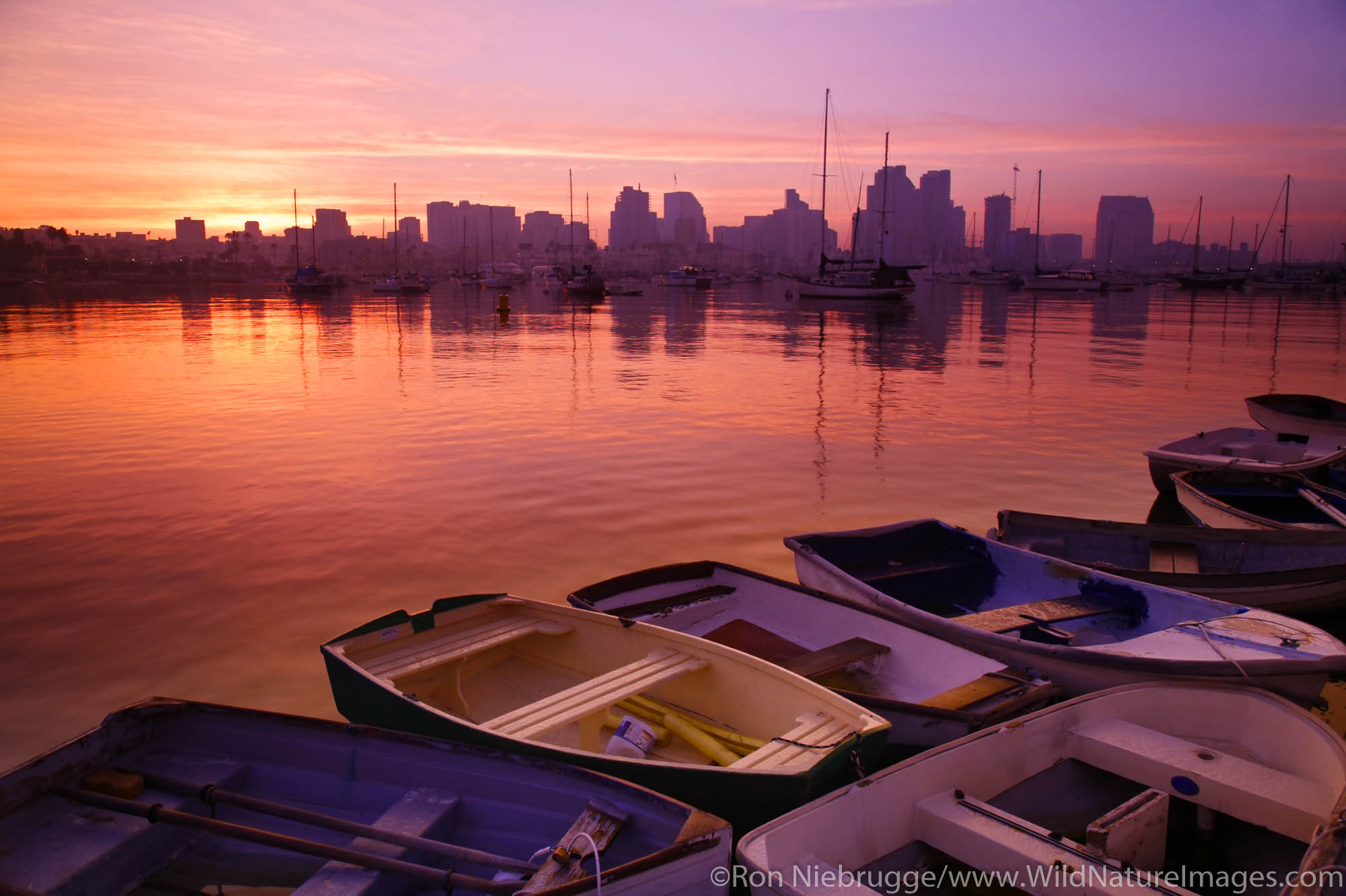 Small boats and the downtown skyline at sunrise, San Diego, California.