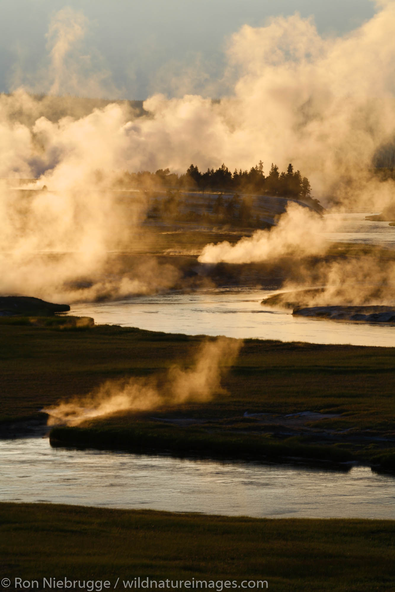 Fishermen in the Firehole River, Midway Geyser Basin, Yellowstone National Park, Wyoming.
