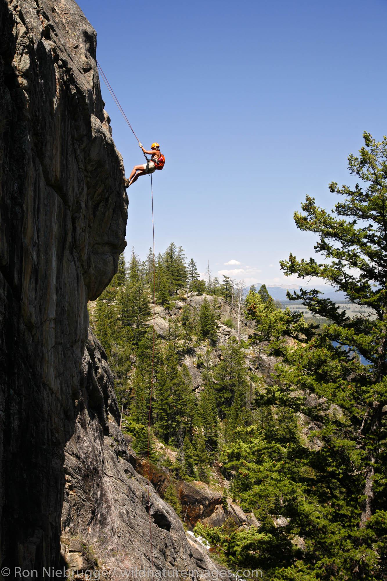 Rock climbing near Hidden Falls with Exum Mountain Guides, Grand Teton National Park, Wyoming. (MR)