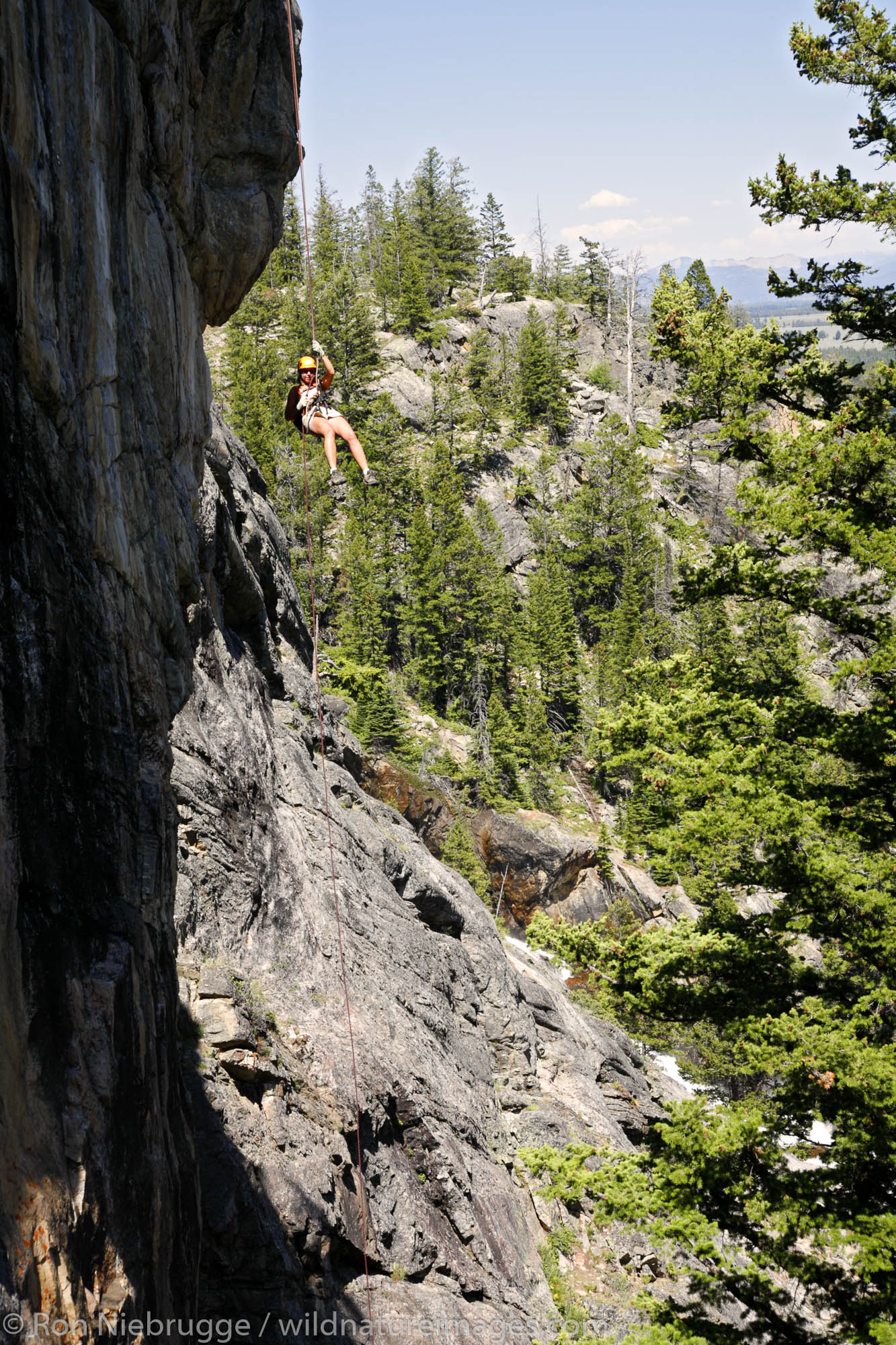 Rock climbing near Hidden Falls with Exum Mountain Guides, Grand Teton National Park, Wyoming. (MR)