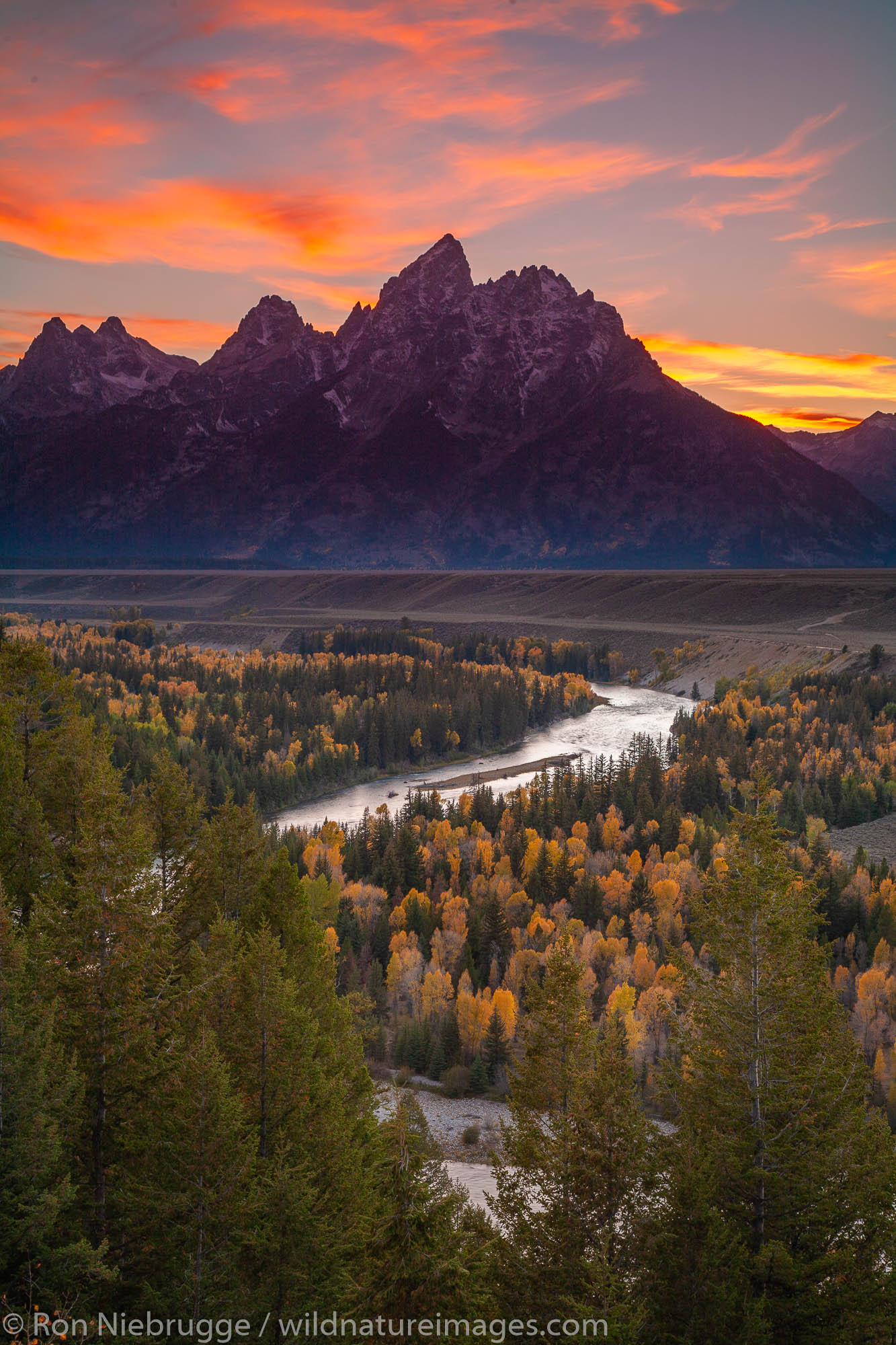 Grand Teton and the Snake River during Fall in the Grand Teton National Park, Wyoming.