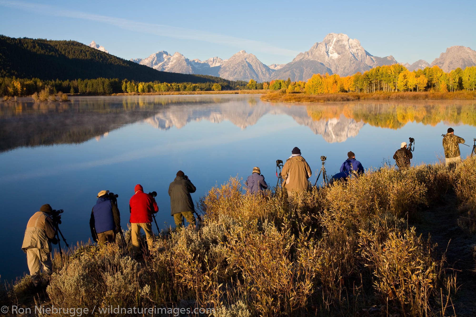 Photographers photographing Mount Moran from Oxbow Bend, Grand Teton National Park, Wyoming.