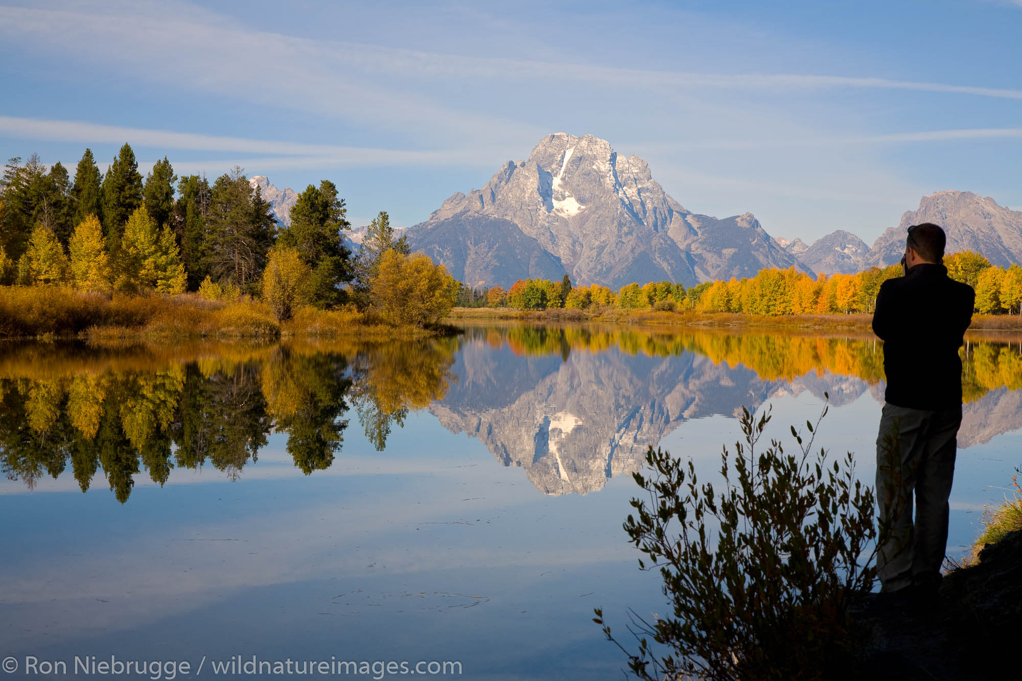 A visitor takes a picture of Mount Moran from Oxbow Bend, Grand Teton National Park, Wyoming.
