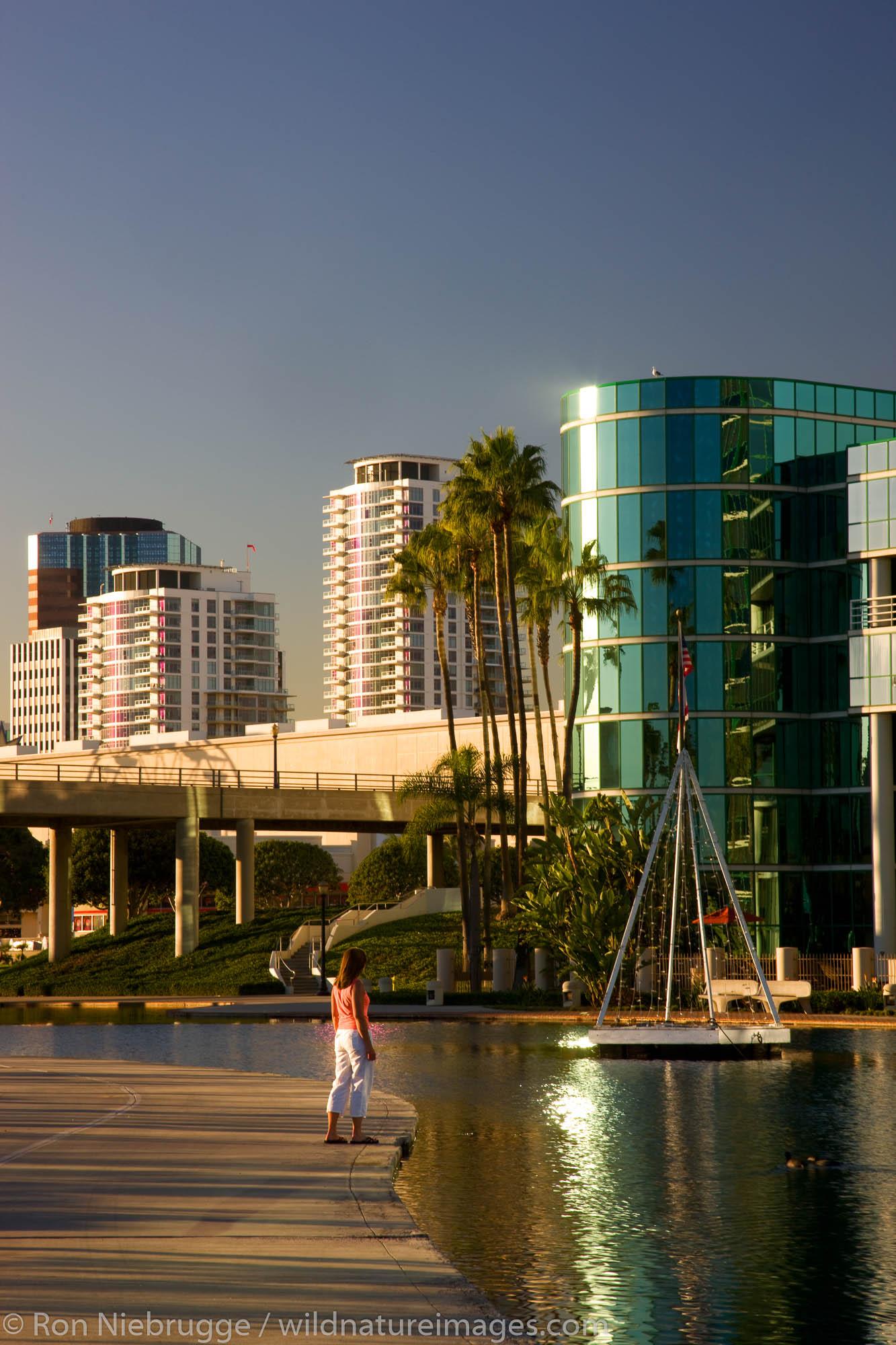 A visitor enjoys Rainbow Lagoon Park, Waterfront Center, Long Beach, California.  (model released)