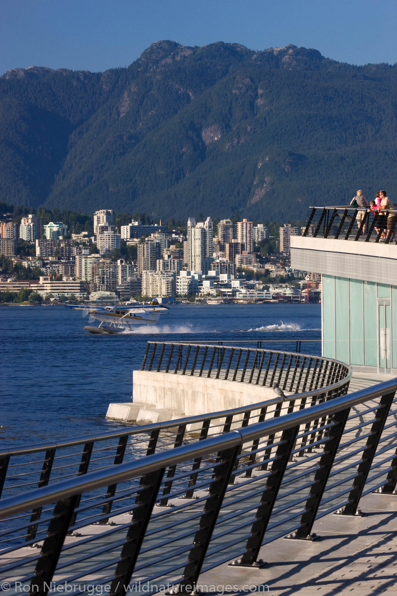 Looking across Coal Harbour towards North Vancouver from the Convention Center, Vancouver, British Columbia, Canada.