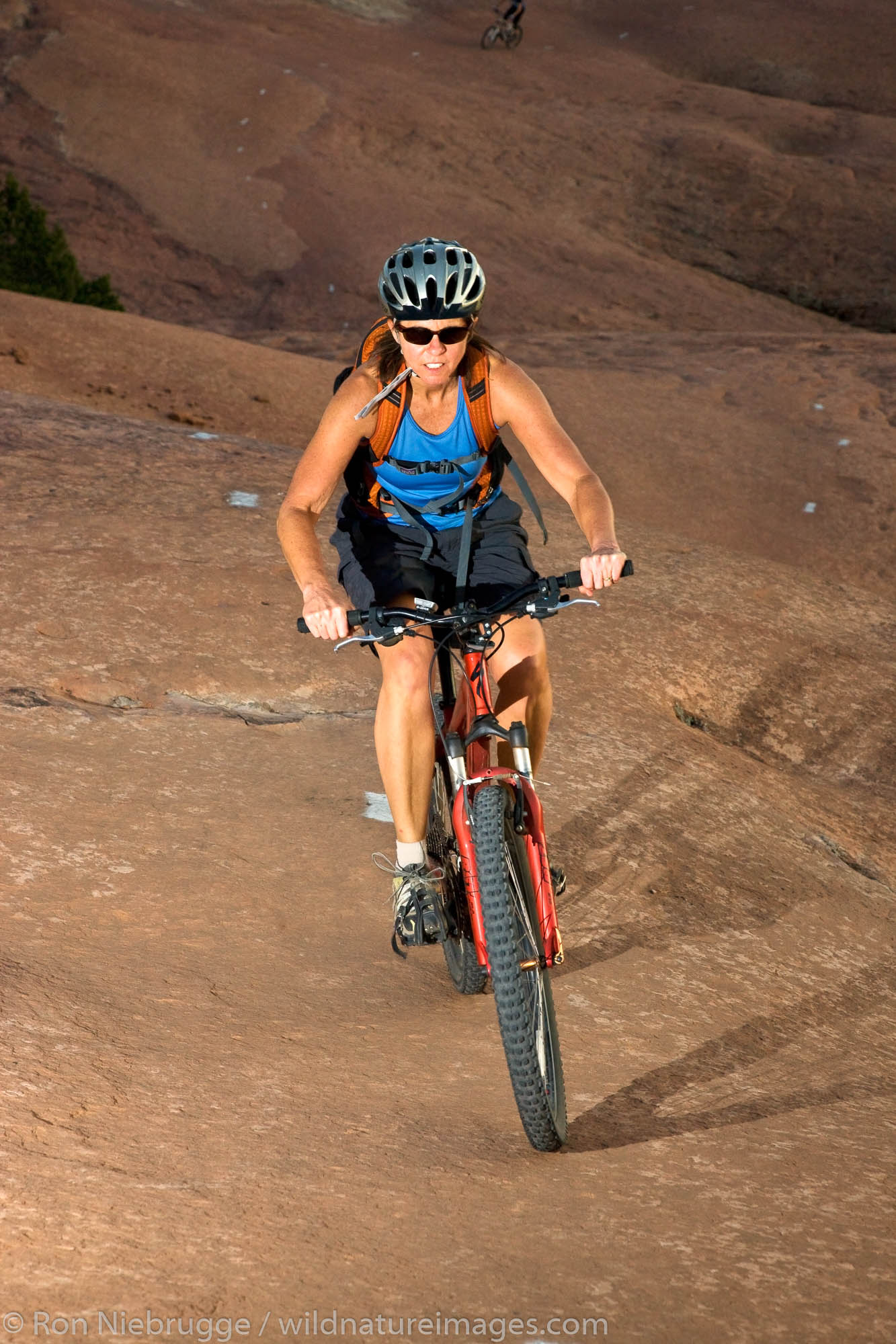 Mountain biking the famous Slickrock Trail, Moab, Utah.  (model released)