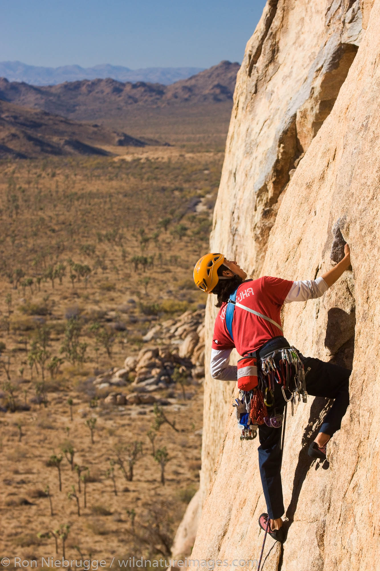 Ernest Sierras rock climbing in Joshua Tree National Park, California.  (model released)