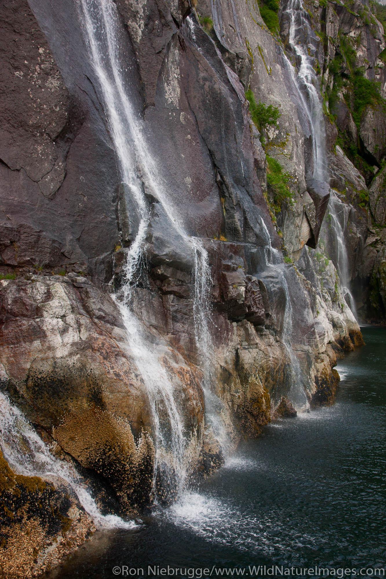 Waterfalls in Cataract Cove, Kenai Fjords National Park, near Seward, Alaska.