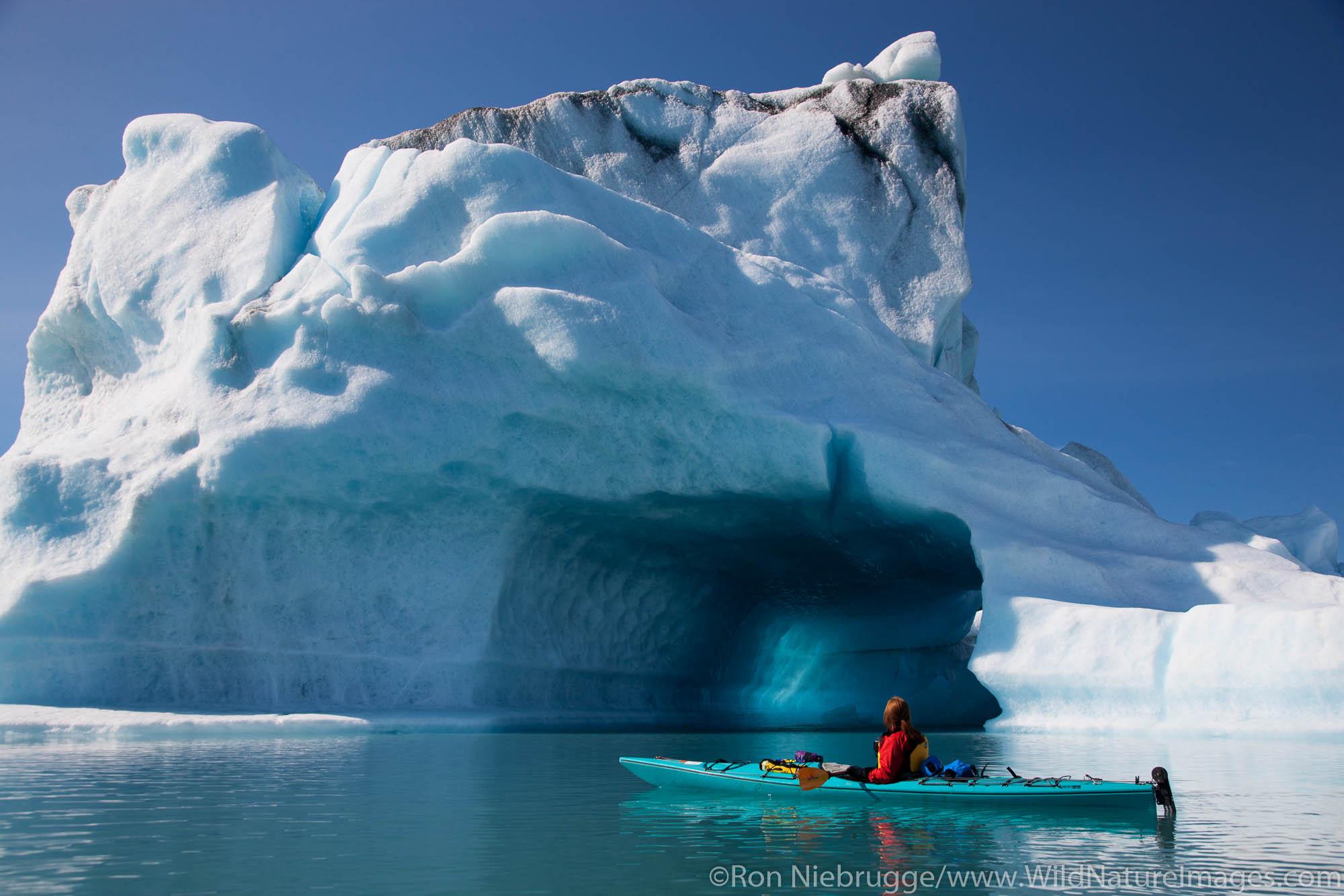Kayaking in Bear Lagoon, Kenai Fjords National Park, near Seward, Alaska. (model released)