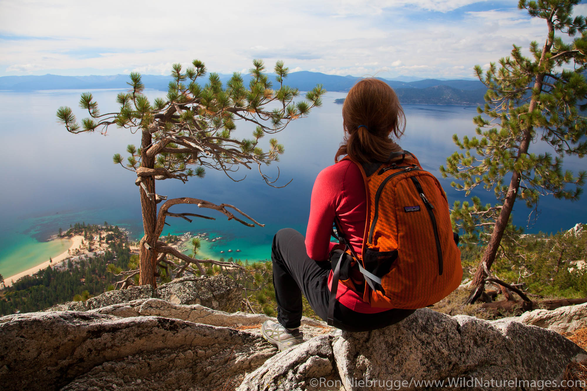 A hiker enjoys the view along the Flume Trail, Lake Tahoe, NV (model released)