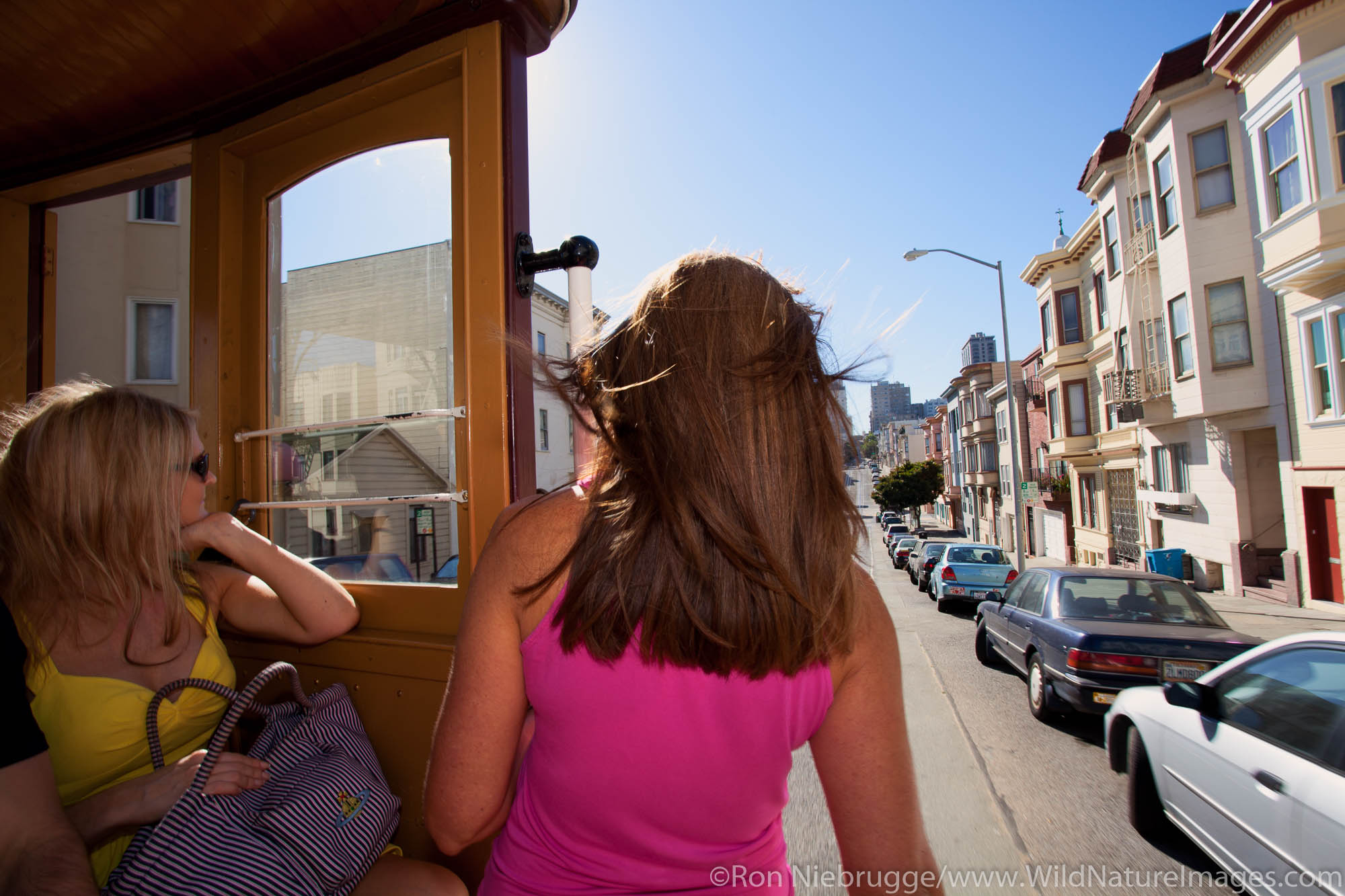 Riding the famous cable cars in San Francisco, CA