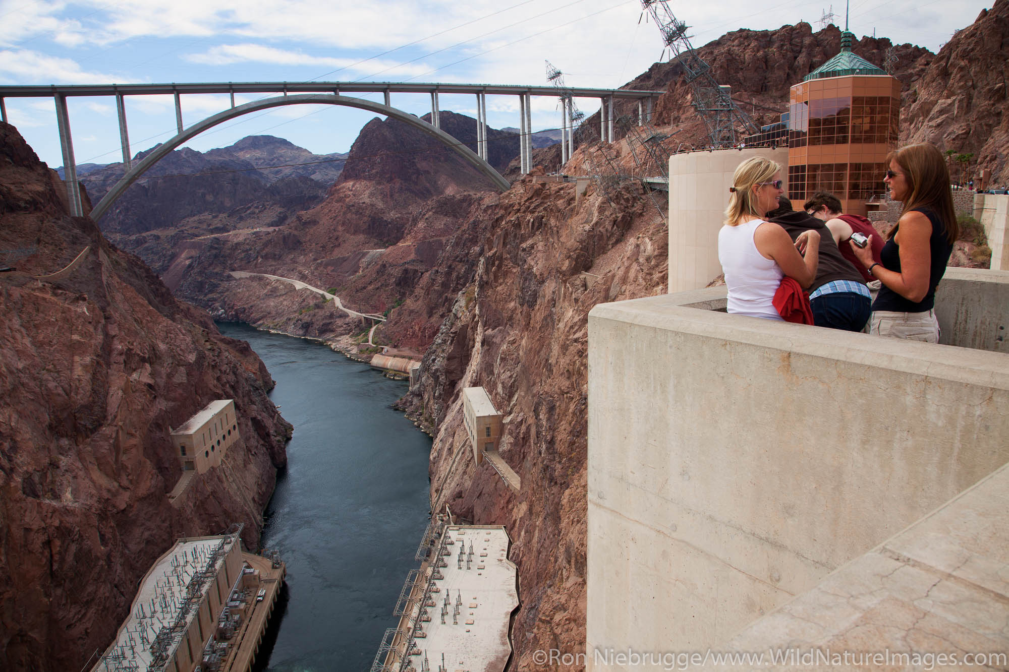 Visitors at Hoover Dam, with Mike O'Callaghan – Pat Tillman Memorial Bridge in the distance, Mojave Desert, AZ