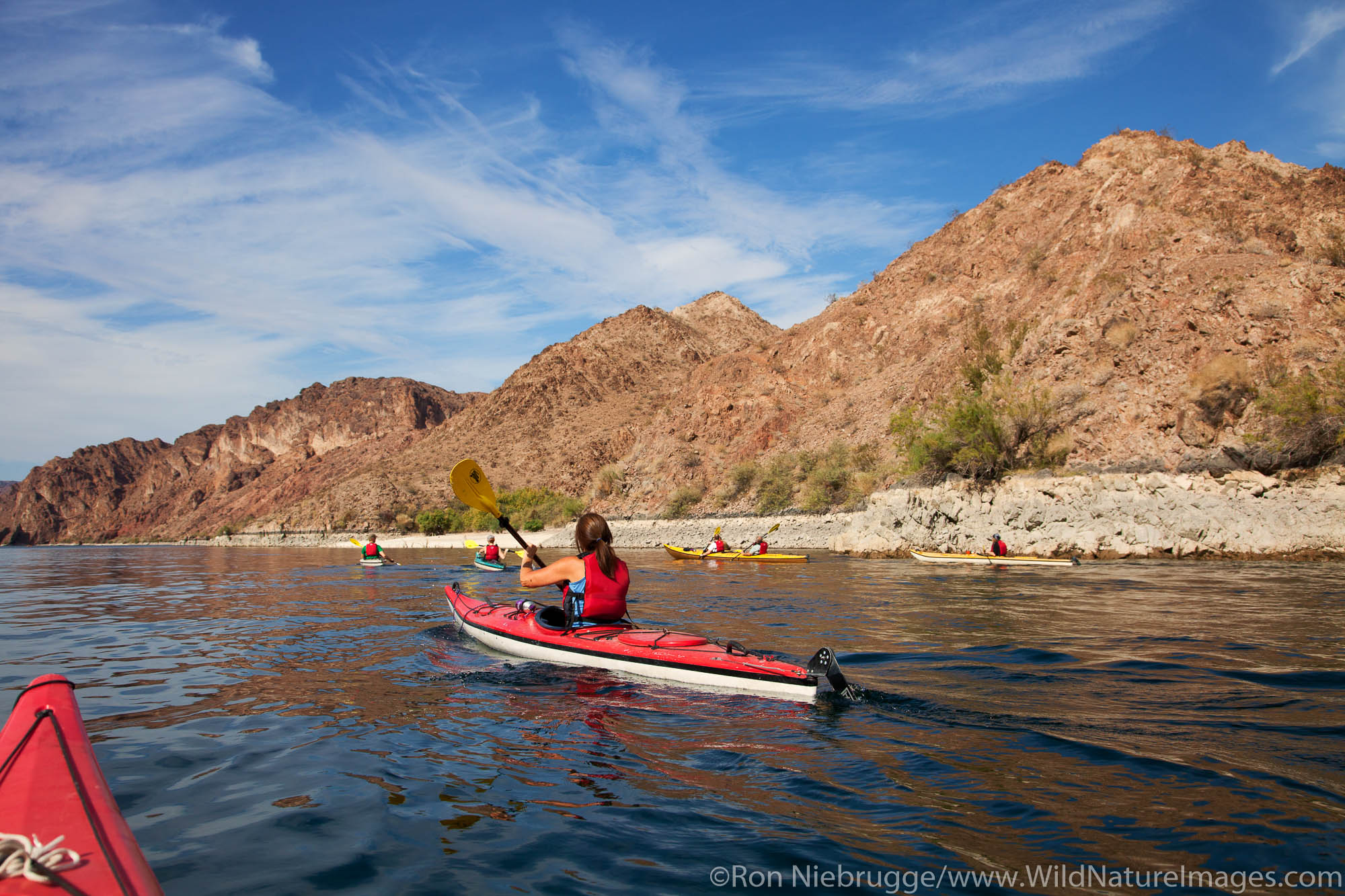 Kayking Black Canyon on the Colorado River, Mojave Desert. (model released)