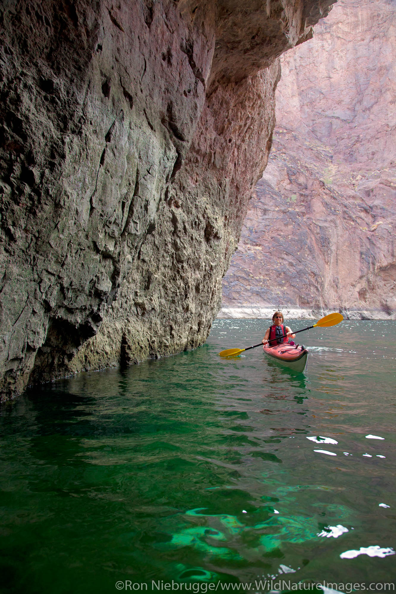 Kayaking in Emerald Cave on the Colorado River, Mojave Desert. (model released)