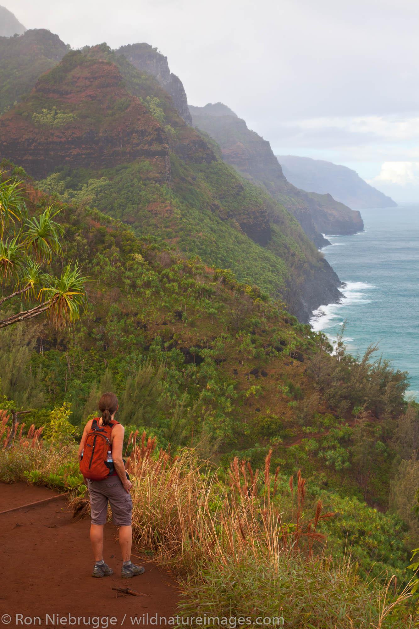 A hiker on the Kalalau Trail, Na Pali Coast, Kauai, Hawaii.  (model released)
