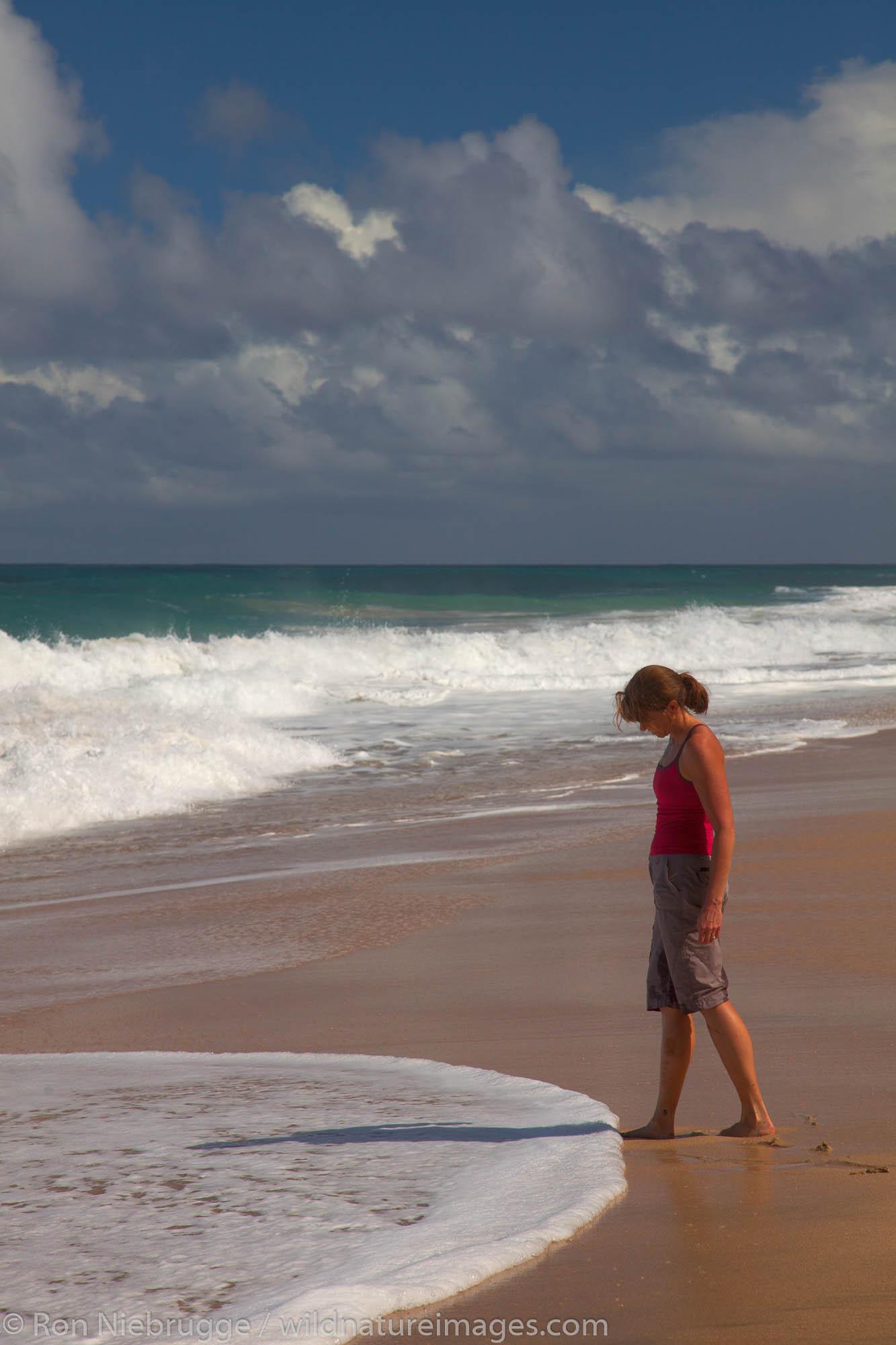 Hiker at Hanakapi'ai Beach along the Kalalau Trail, Na Pali Coast, Kauai, Hawaii.  (Model Released)