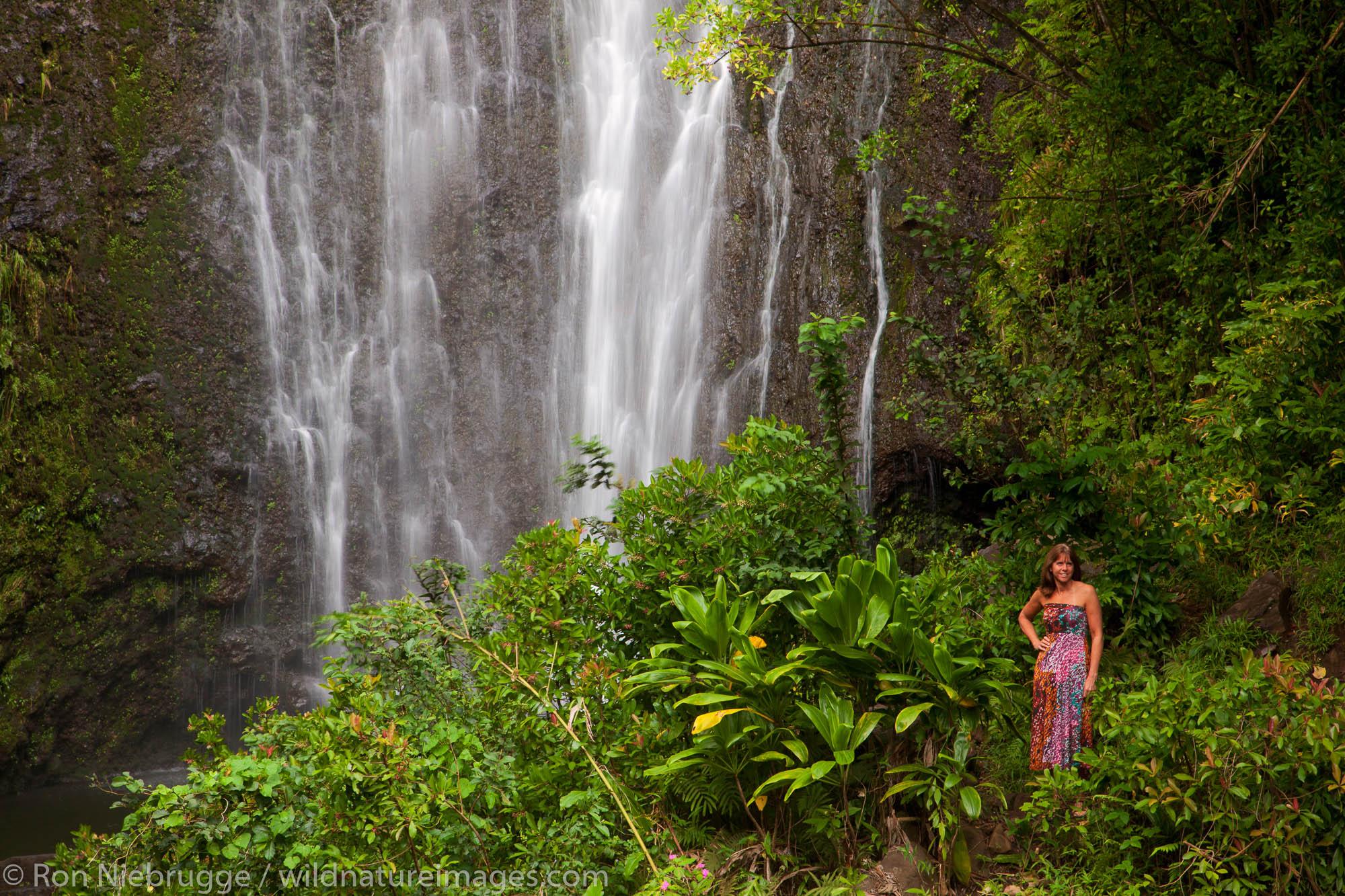 A visitor at Wailua Falls, near Hana, Maui, Hawaii.  (model released)