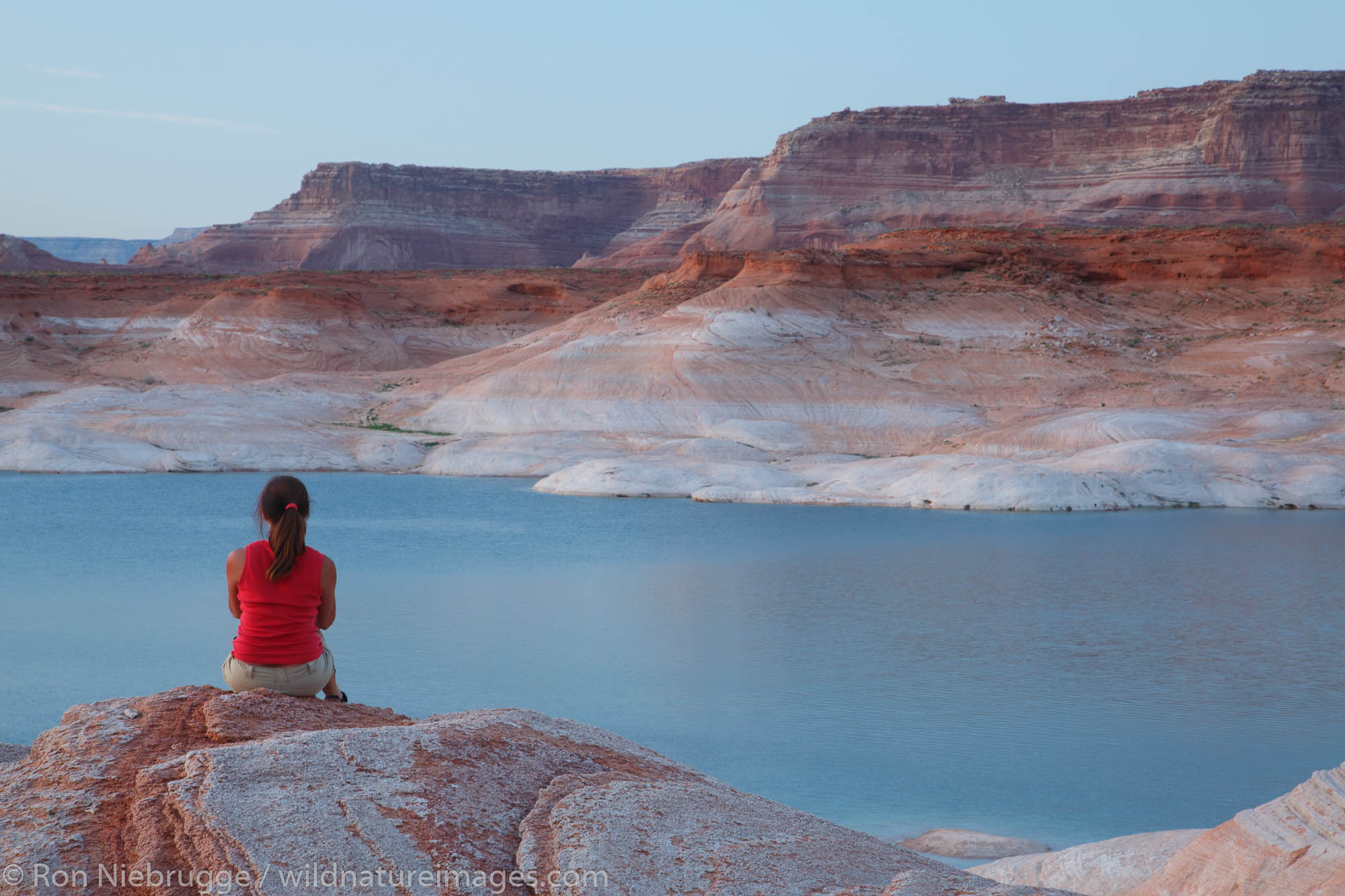 A visitor at West Canyon Lake Powell Glen Canyon National Recreation Area Page Arizona. (model released)