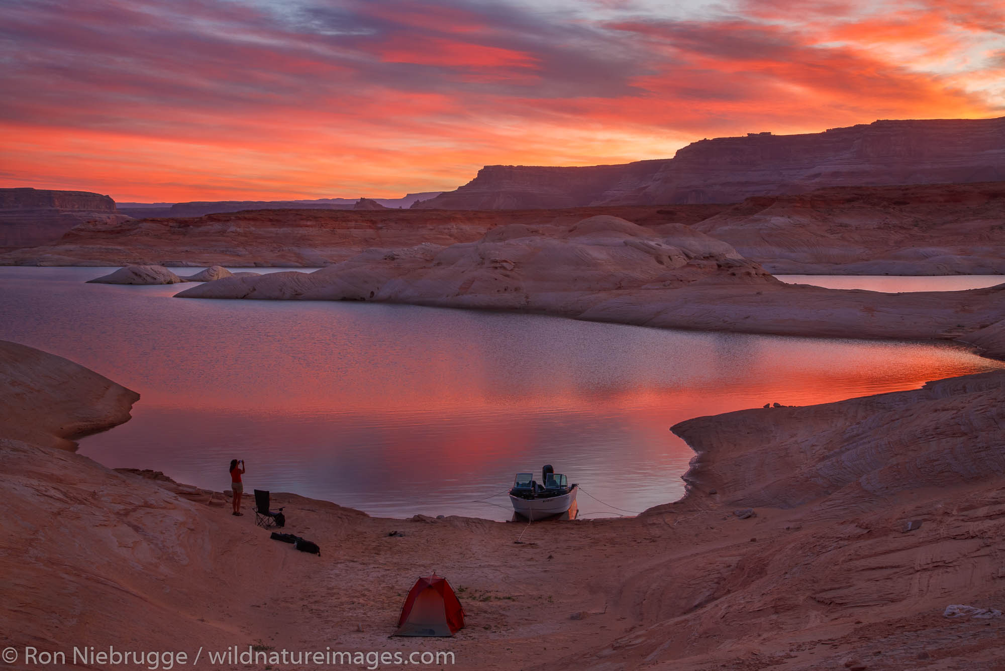 Camping in West Canyon at sunrise Lake Powell Glen Canyon National Recreation Area Page Arizona.