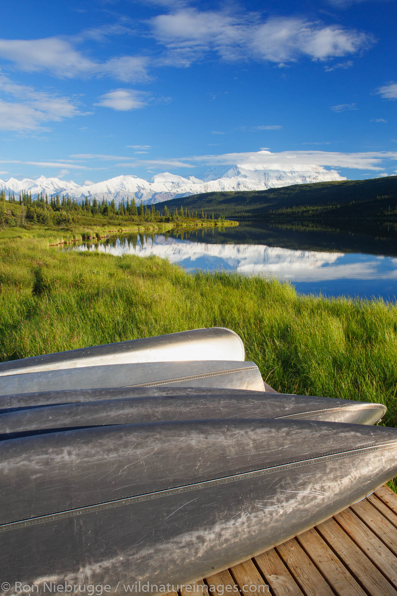 Canoes in front of Mt. McKinley, also known as Denali, from Wonder Lake, Denali National Park, Alaska.