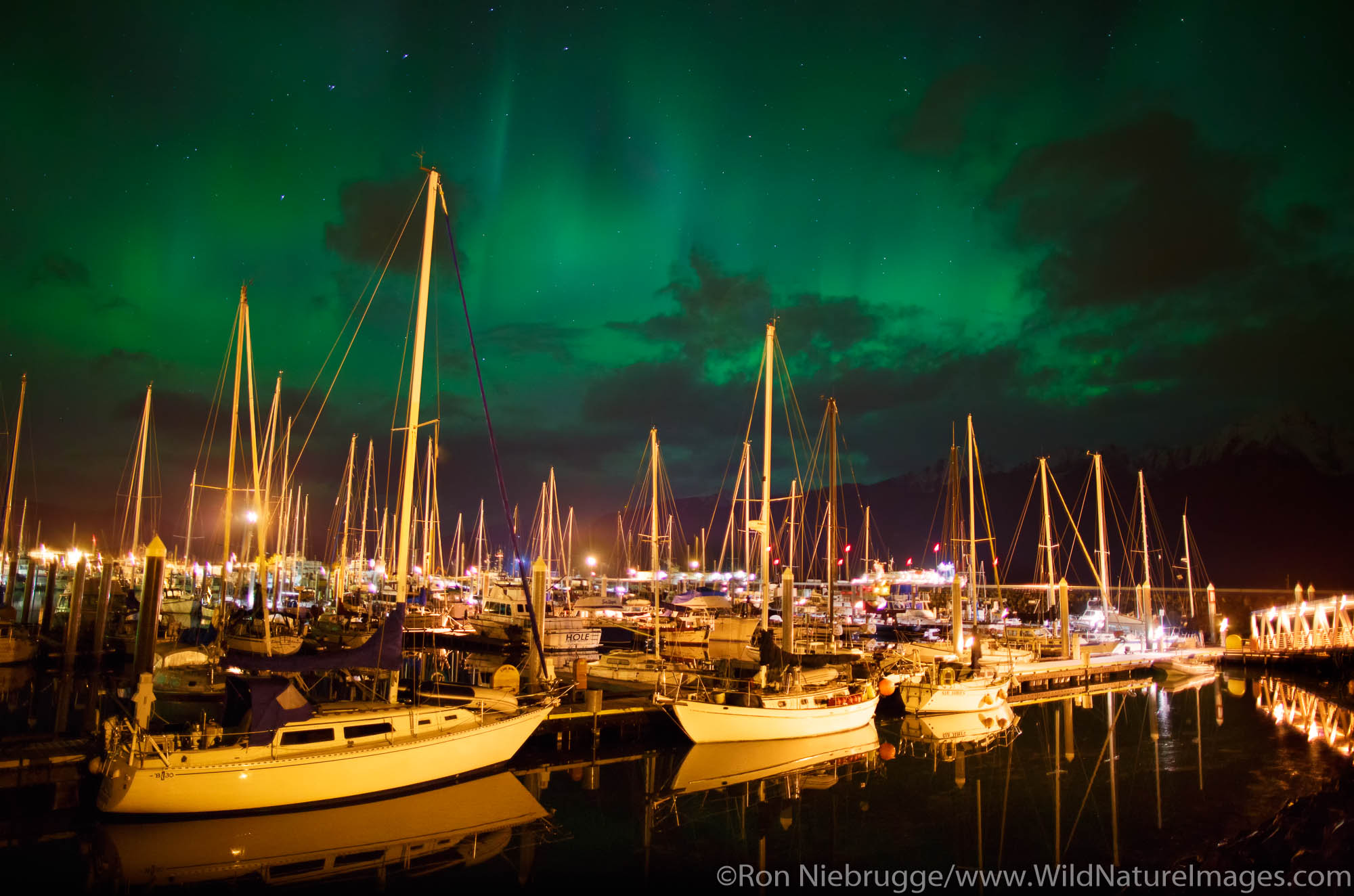 Aurora borealis over Seward Boat Harbor,  Resurrection Bay, Seward, Alaska.