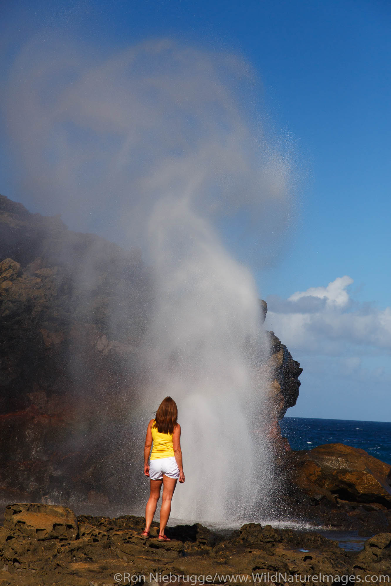 Visitor at the Nakalele Blowhole, Maui, Hawaii.  (model released)