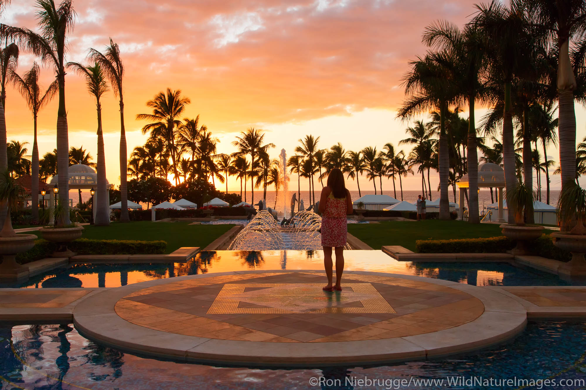 Visitor enjoying sunset, Grand Wailea, Maui, Hawaii.  (model released)